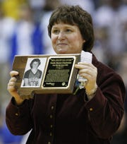 Natalie Streeter-Chamberlain holds a plaque as she is named to the Montana High School Association Athletes Hall of Fame during ceremonies in her hometown of Great Falls in 2011.