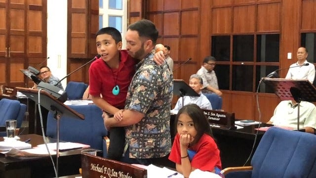 Sen. Mike San Nicolas' son, Kaleb, addresses senators on Wednesday night while San Nicolas' other child, Katelyn, looks on. Senators not returning in the next Legislature bid their goodbyes and thanked their colleagues, staff, family and the public for giving them the chance to serve them for years.