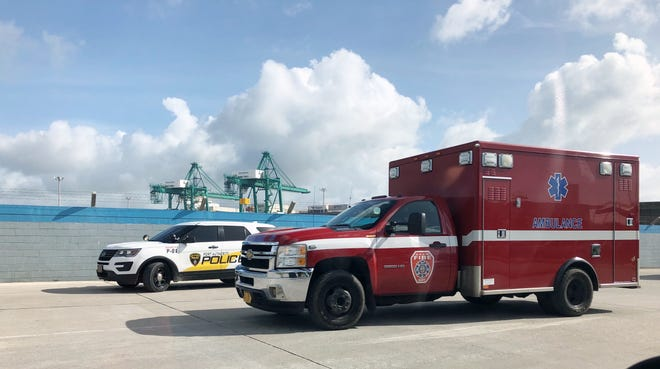 An ambulance leaves the Port Authority of Guam on Wednesday afternoon after a gantry crane operator was injured.
