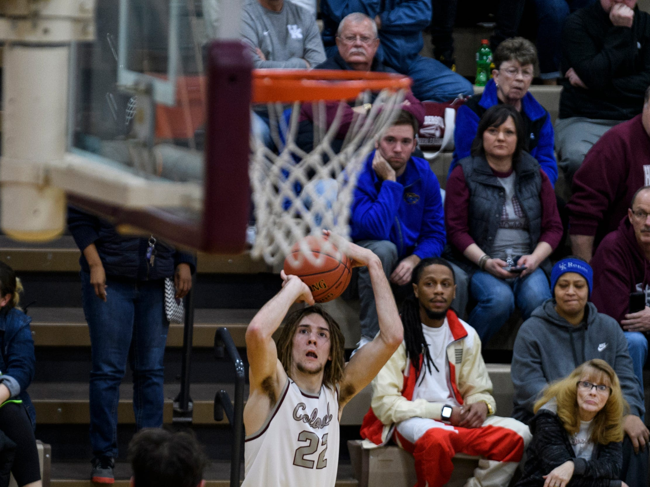 Henderson's Nick Cissell (22) makes a three-pointer during the second quarter against the Crittenden County Rockets at Henderson County High School in Henderson, Ky., Tuesday, Dec. 18, 2018.  The Colonels defeated the Rockets 88-52.