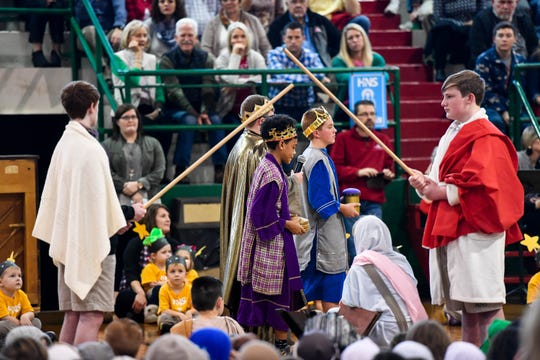 Students reenact the nativity during the Holy Name School Christmas program Wednesday, December 19, 2018.