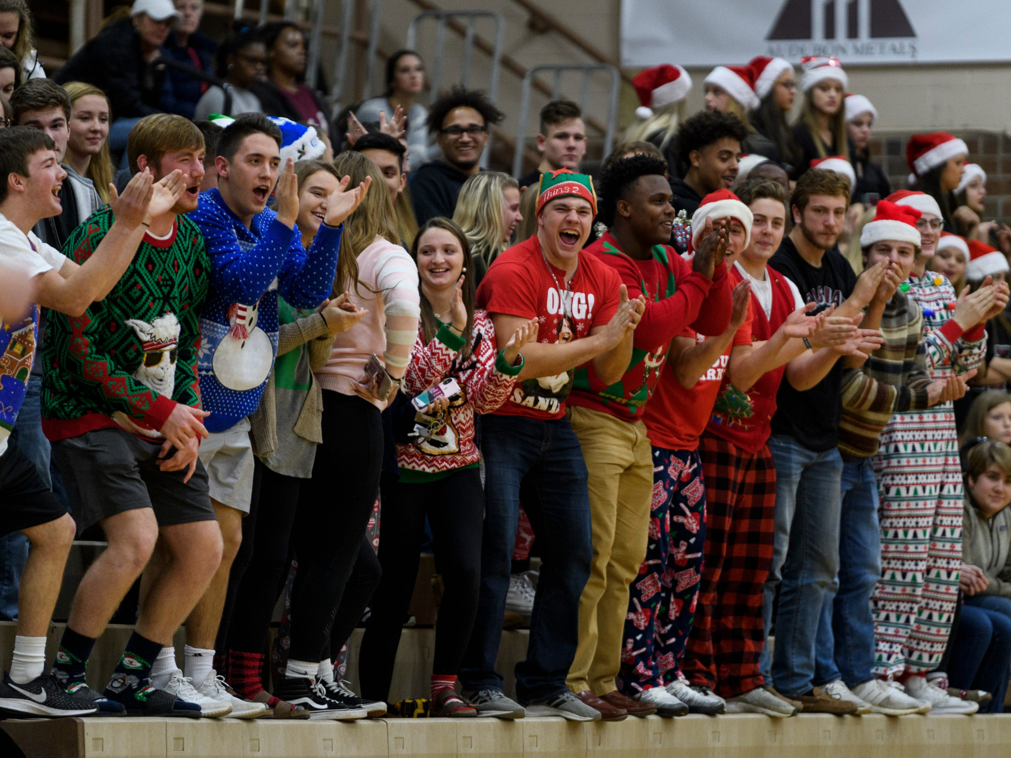 The Henderson County Colonels student section cheers loudly as their team takes on the Crittenden County Rockets at Henderson County High School in Henderson, Ky., Tuesday, Dec. 18, 2018. The team made 19 three-pointers, breaking a school record, and defeated the Rockets 88-52.