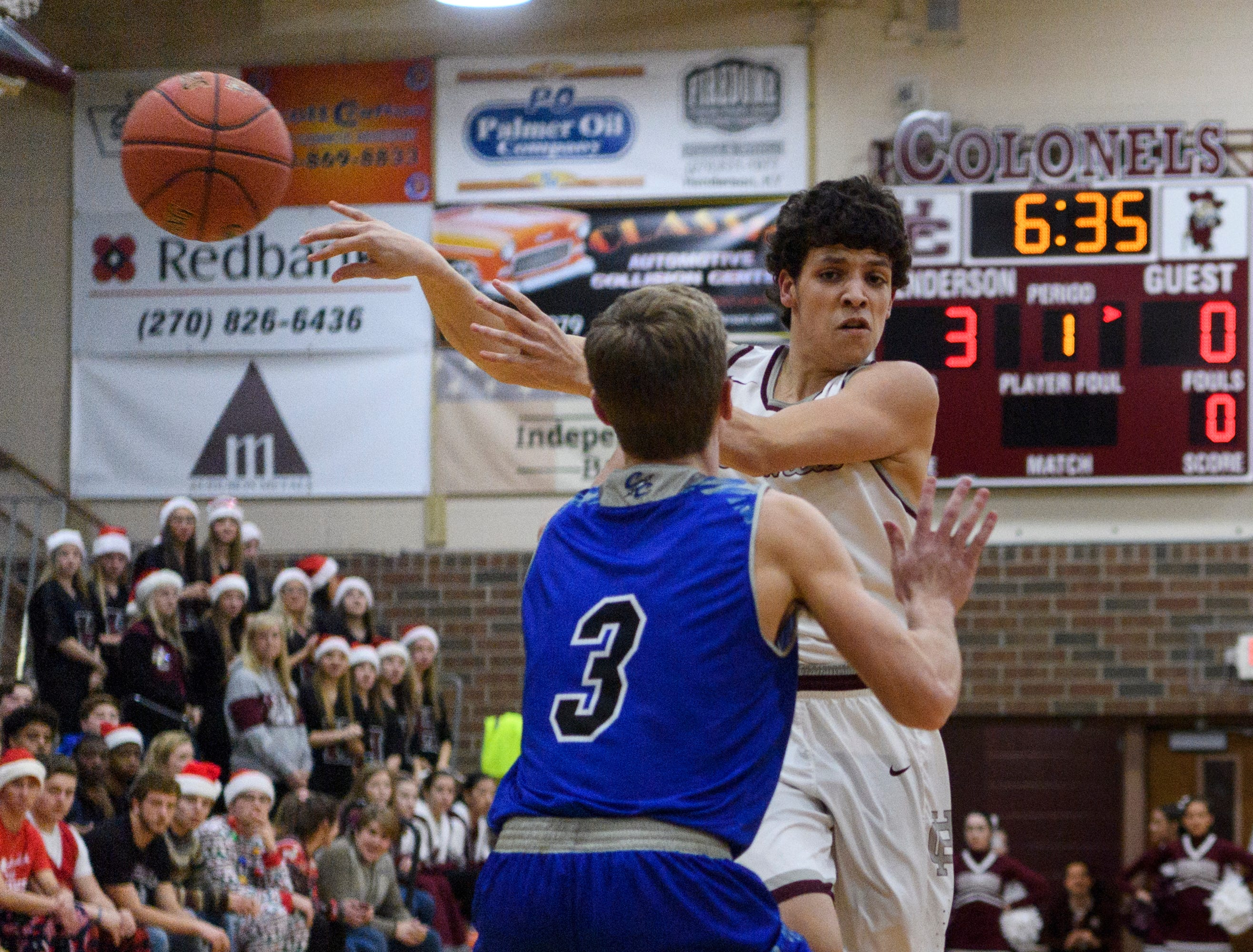 Henderson's Corey Stewart (1) passes the ball around Crittenden County's Sawyer Towery (3) during the first quarter at Henderson County High School in Henderson, Ky., Tuesday, Dec. 18, 2018. The Colonels defeated the Rockets 88-52.