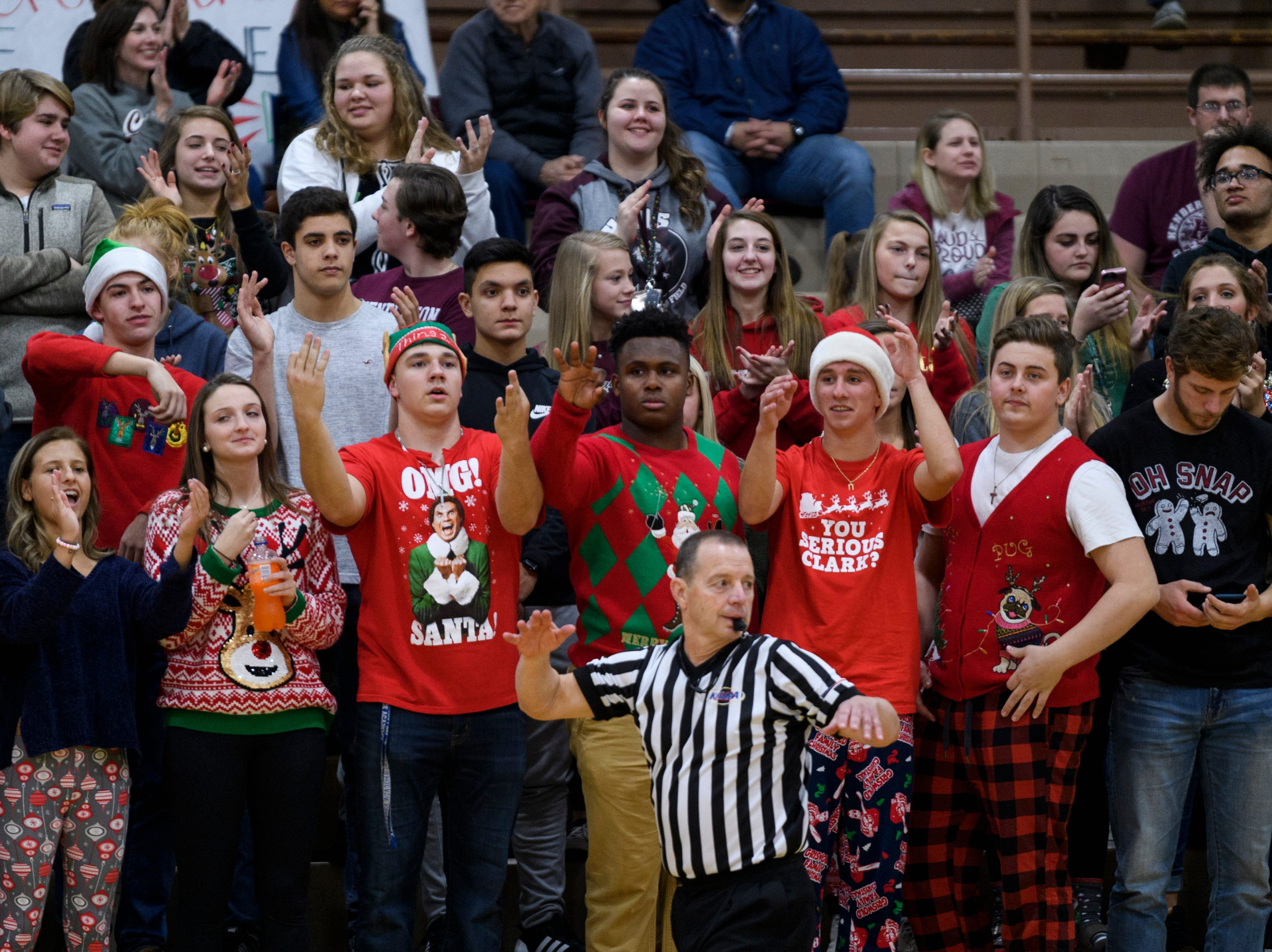 The Henderson County Colonels student section reacts to their team putting more points on the board against the Crittenden County Rockets at Henderson County High School in Henderson, Ky., Tuesday, Dec. 18, 2018. The Colonels defeated the Rockets 88-52.