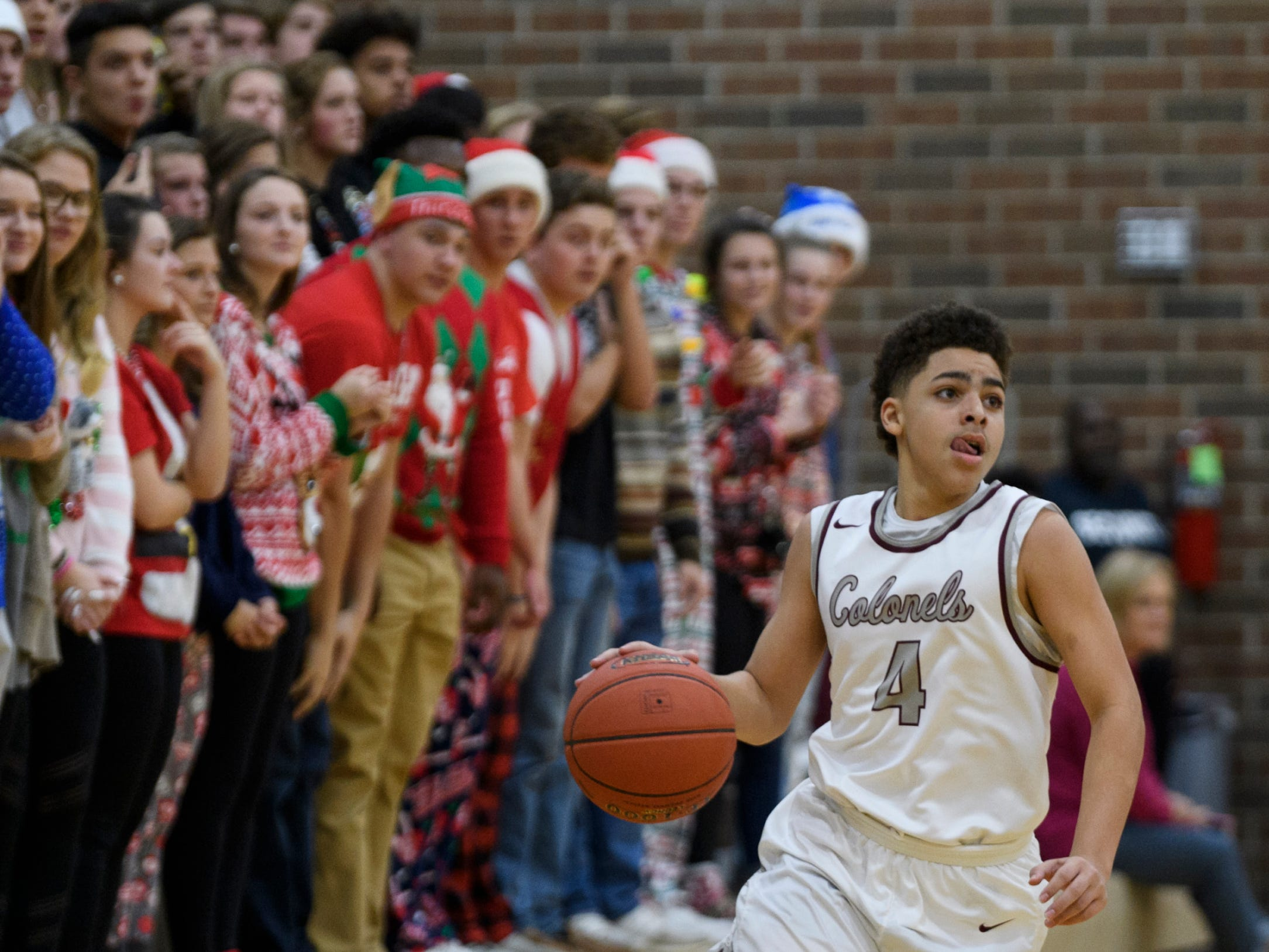 Henderson's Noah Curry (4) dribbles down the court during the second quarter against the Crittenden County Rockets at Henderson County High School in Henderson, Ky., Tuesday, Dec. 18, 2018.  The Colonels defeated the Rockets 88-52.