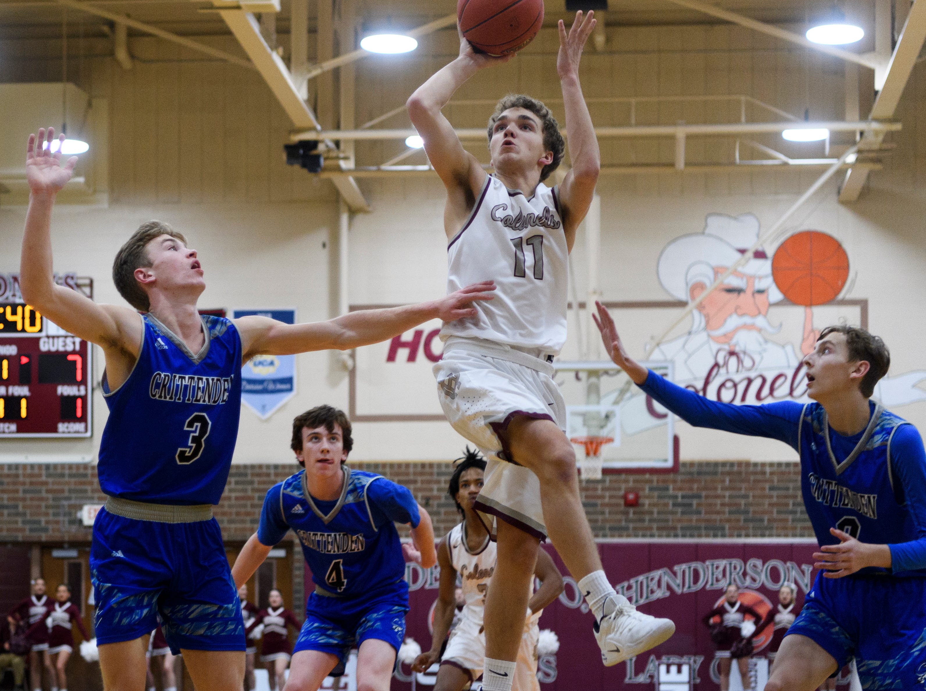 Henderson's Luke Fulkerson (11) takes a shot against the Crittenden County Rockets during the first quarter at Henderson County High School in Henderson, Ky., Tuesday, Dec. 18, 2018. The Colonels defeated the Rockets 88-52.