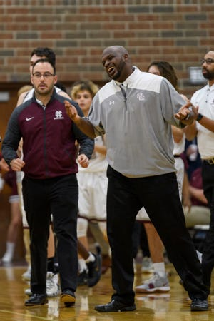 Henderson Coutnty assistant coach Brock Stone (right) was named the new girls basketball coach at Webster County.