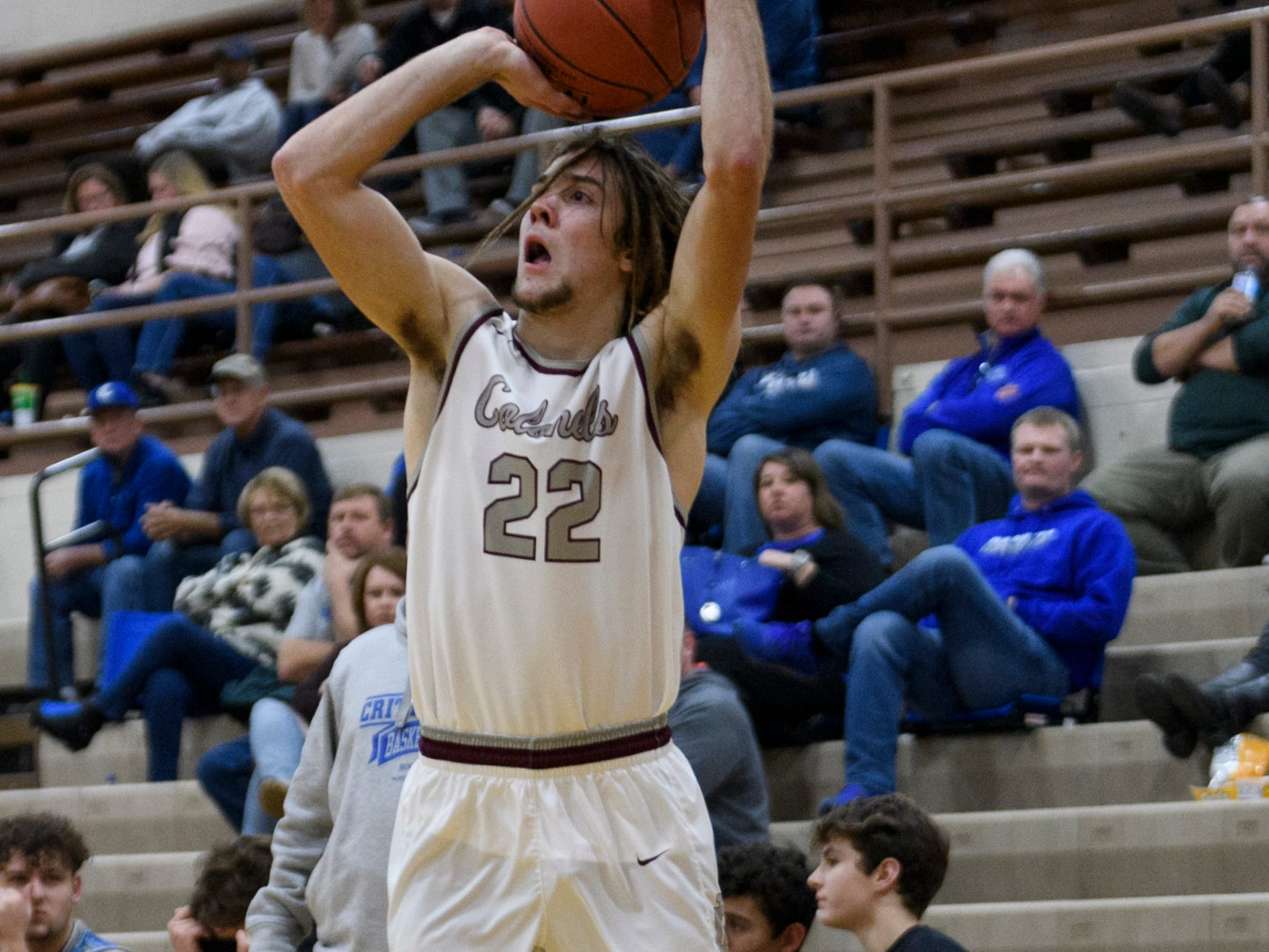 Henderson's Nick Cissell (22) makes a three-pointer during the first quarter against the Crittenden County Rockets at Henderson County High School in Henderson, Ky., Tuesday, Dec. 18, 2018. The Colonels defeated the Rockets 88-52.