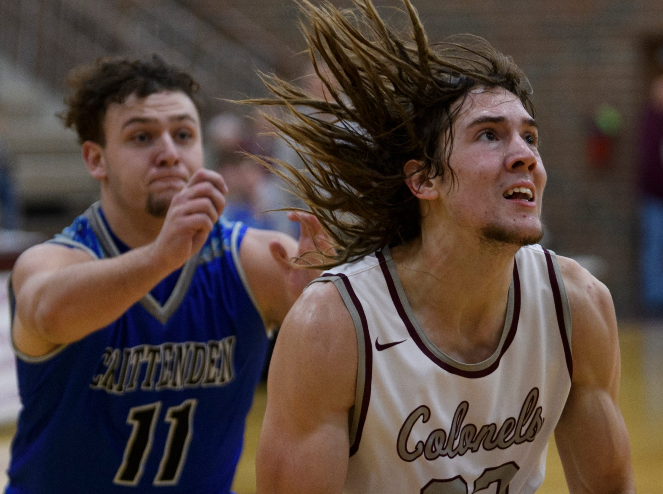 Henderson's Nick Cissell (22) prepares to take a shot against the Crittenden County Rockets in the fourth quarter at Henderson County High School in Henderson, Ky., Tuesday, Dec. 18, 2018. The Colonels defeated the Rockets 88-52.