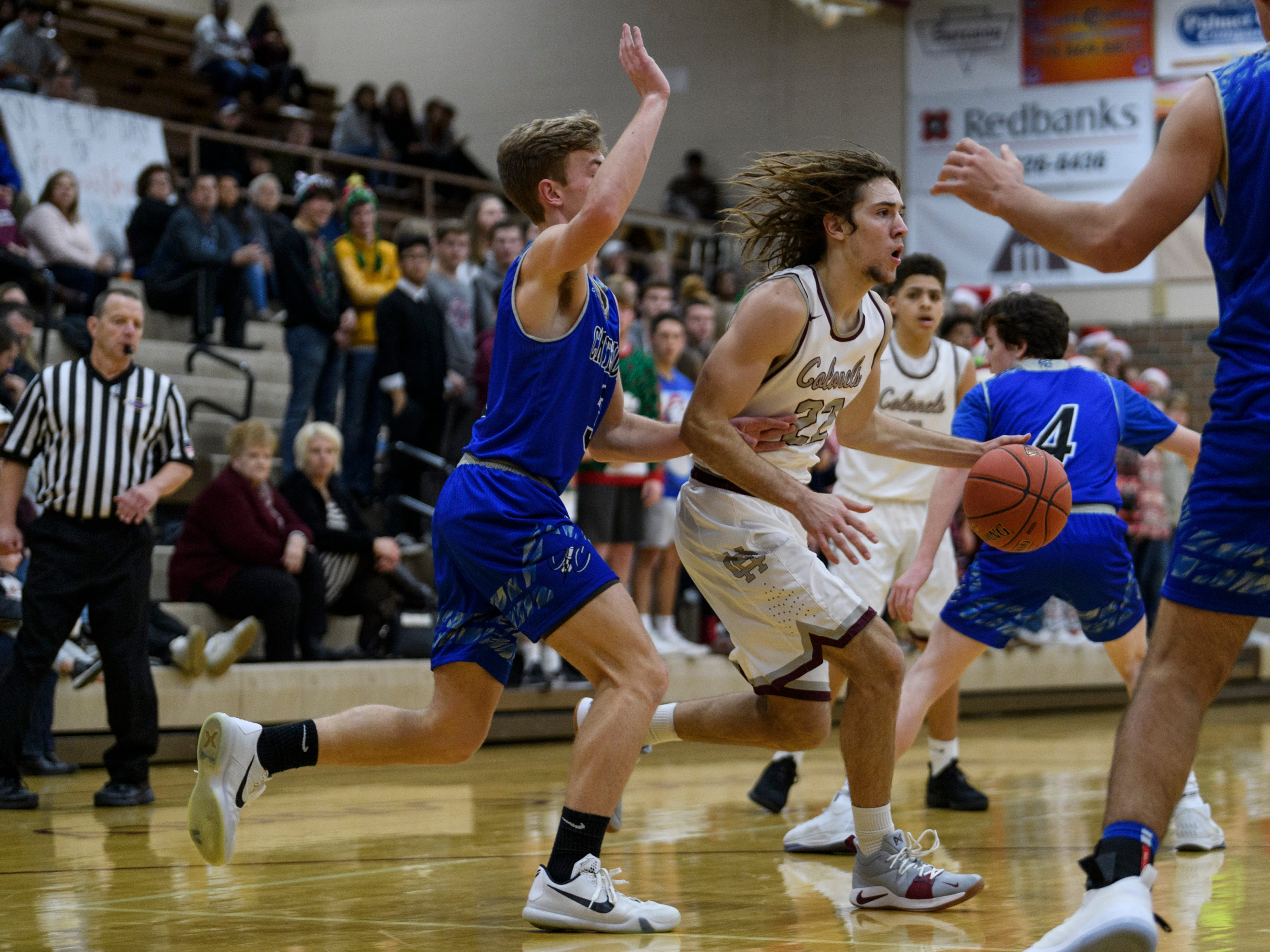 Henderson's Nick Cissell (22) dribbles past Crittenden County's Sawyer Towery (3) during the first quarter at  Henderson County High School in Henderson, Ky., Tuesday, Dec. 18, 2018. The Colonels defeated the Rockets 88-52.
