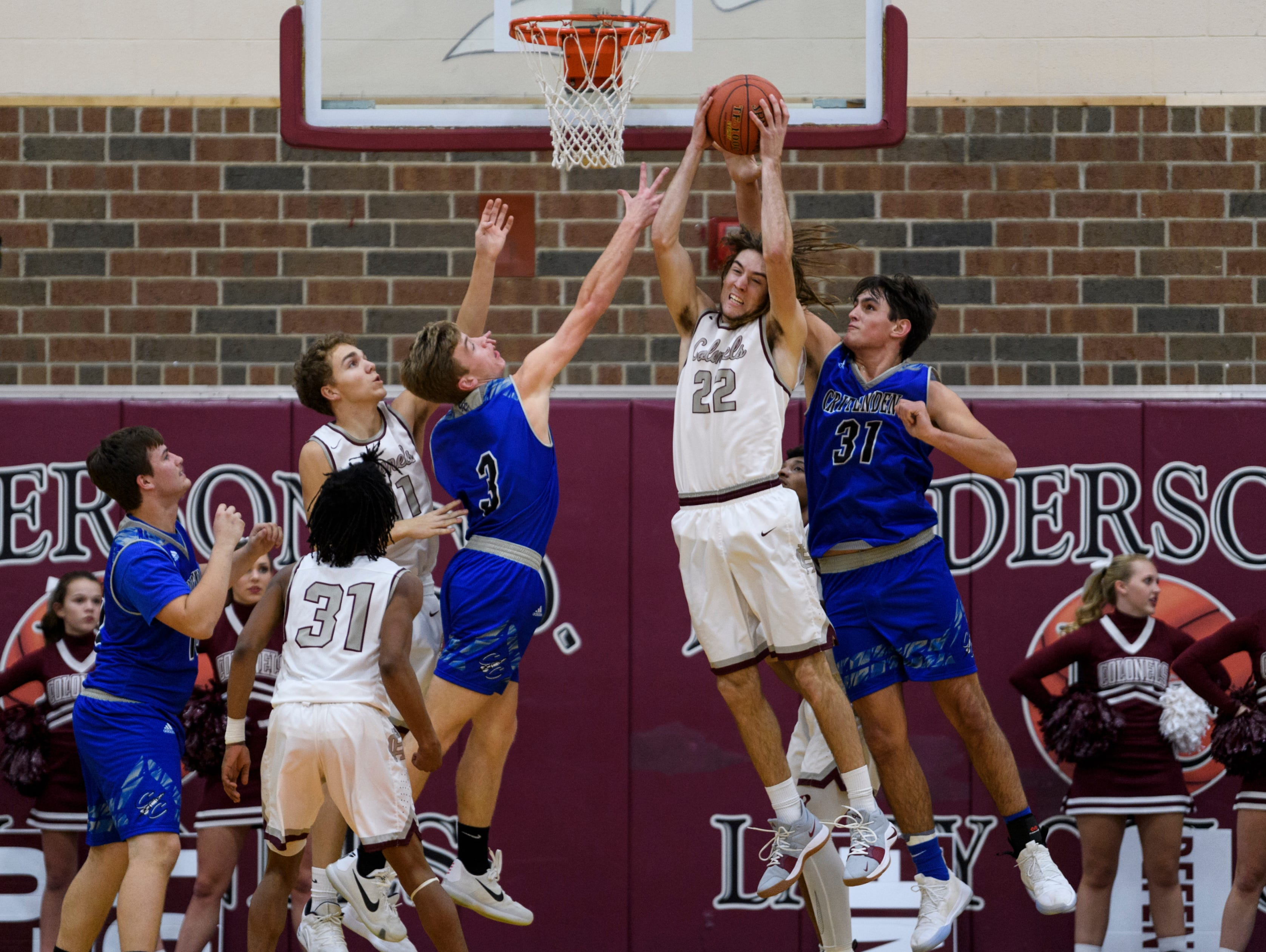 Henderson's Nick Cissell (22) snatches the rebound from Crittenden County's Preston Turley (31) during the first quarter at Henderson County High School in Henderson, Ky., Tuesday, Dec. 18, 2018. The Colonels defeated the Rockets 88-52.