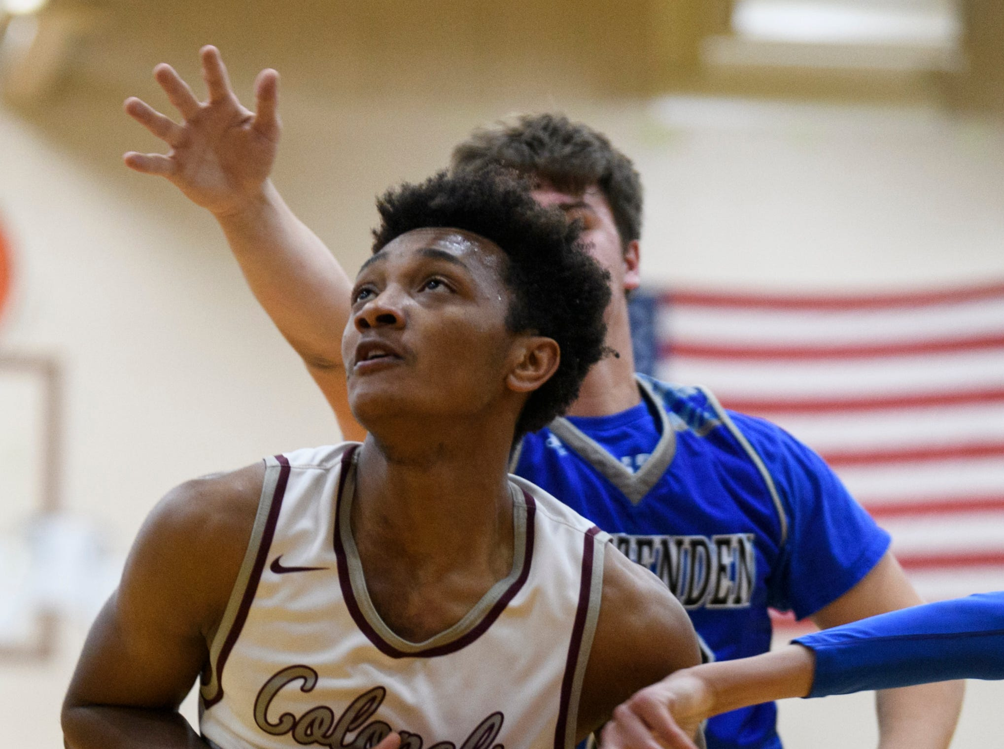 Henderson's Daymian Dixon (3) is guarded by Crittenden County's Gavin Dickerson (10) and Erik O'Leary (2) during the first quarter at Henderson County High School in Henderson, Ky., Tuesday, Dec. 18, 2018. The Colonels defeated the Rockets 88-52.