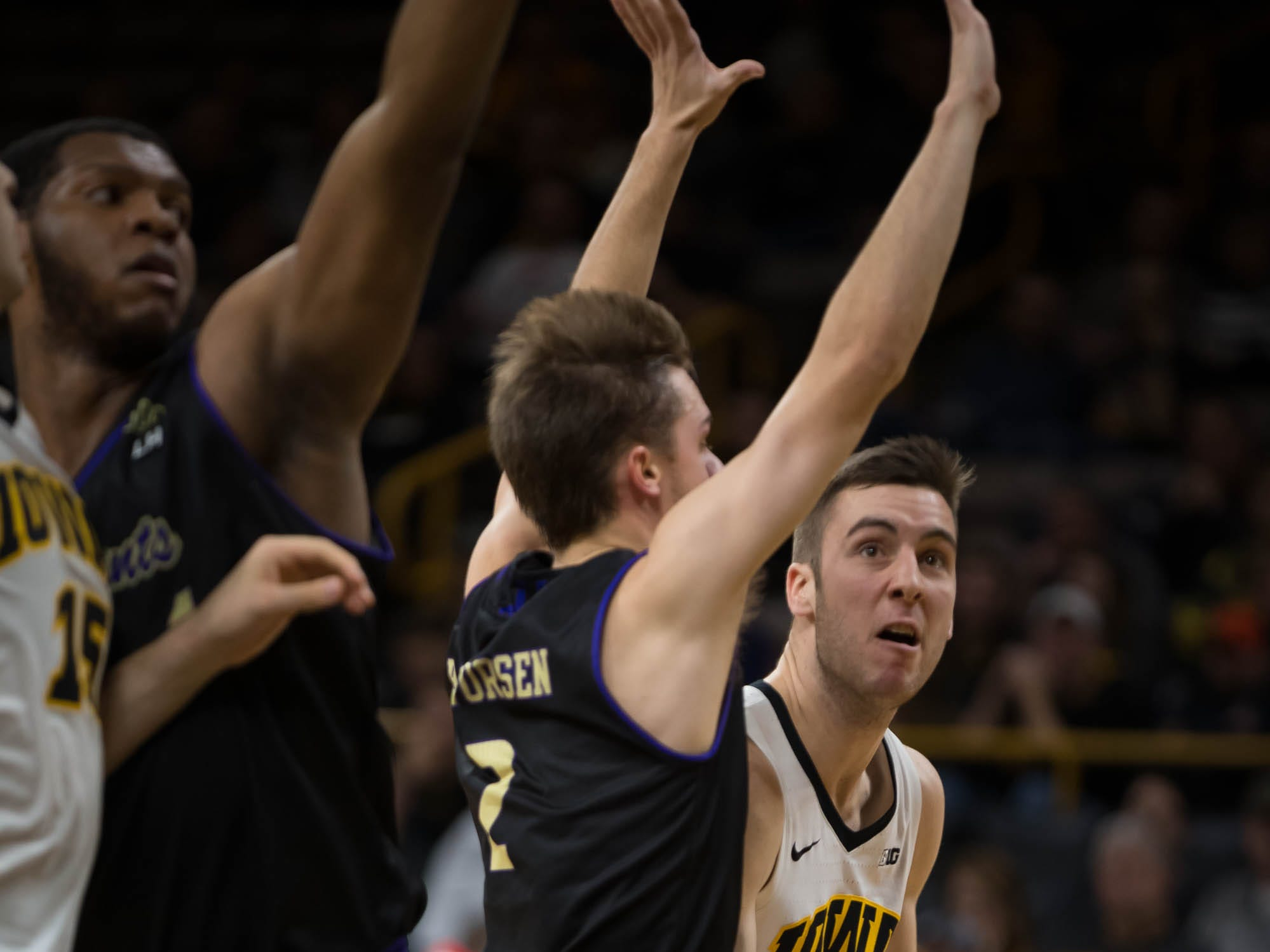 Iowa redshirt freshman guard Connor McCaffery (30) drives against Western Carolina sophomore guard Matt Halvorsen (2) in the first half at Carver Hawkeye Arena in Iowa City on Tuesday, Dec. 18, 2018.