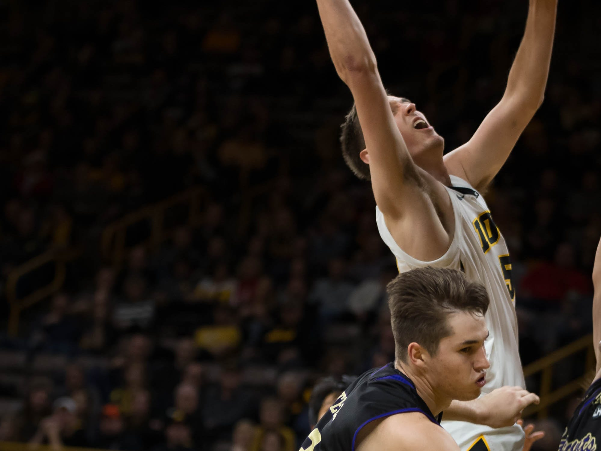 Iowa senior forward Nicholas Baer (51) reaches for a layup in the first half at Carver Hawkeye Arena in Iowa City on Tuesday, Dec. 18, 2018.