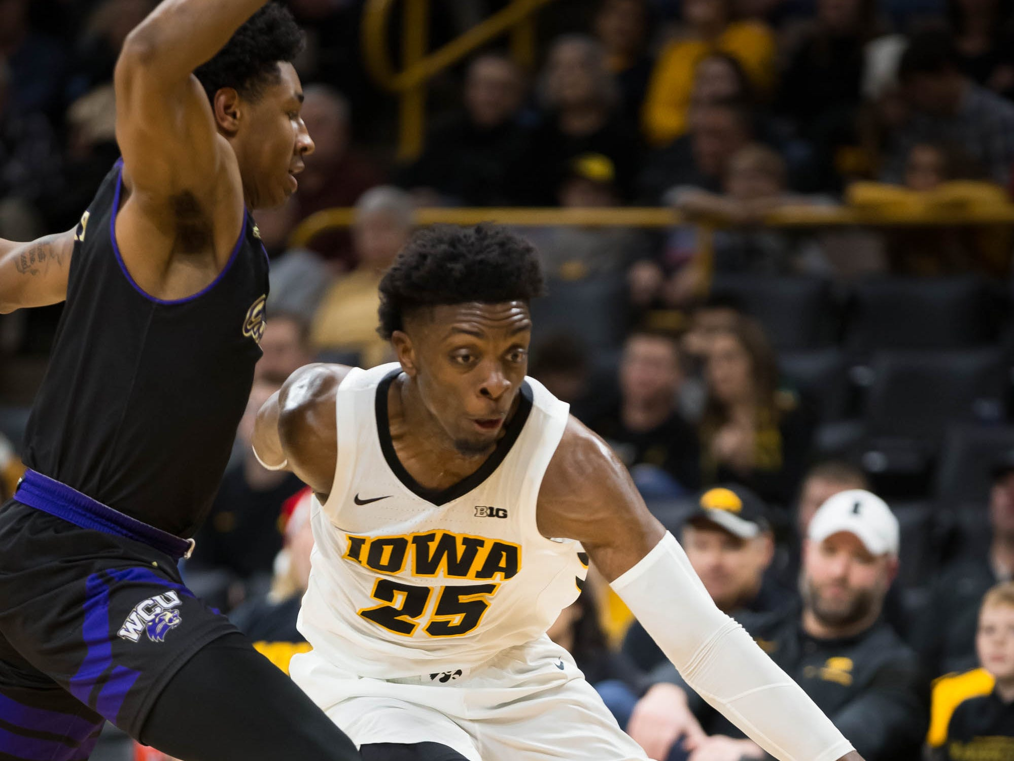 Iowa junior forward Tyler Cook (25) drives against Western Carolina freshman forward D.J. Myers (5) in the first half at Carver Hawkeye Arena in Iowa City on Tuesday, Dec. 18, 2018.