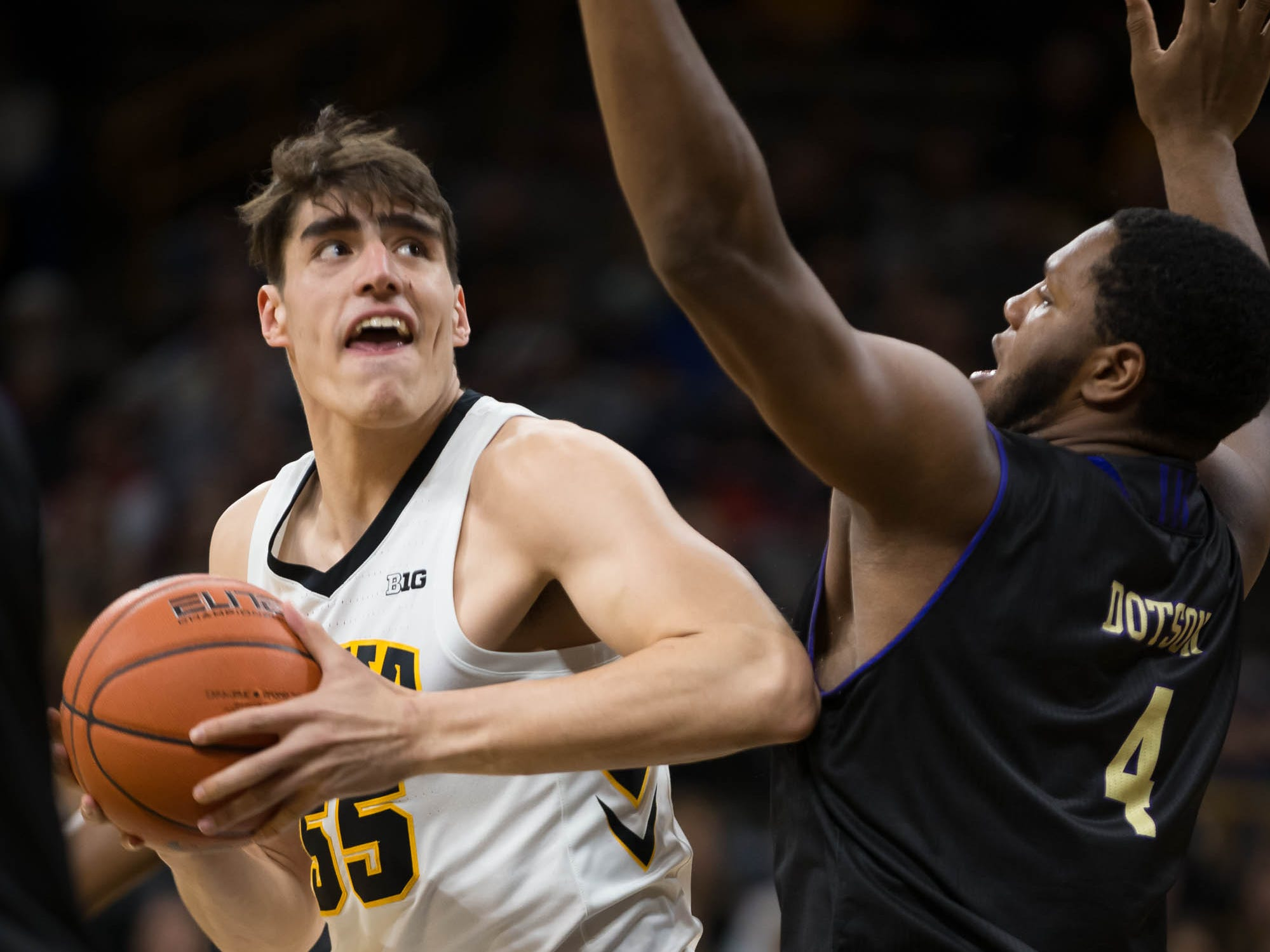 Iowa sophomore forward Luka Garza (55) drives against Western Carolina junior forward Carlos Dotson (4) in the first half at Carver Hawkeye Arena in Iowa City on Tuesday, Dec. 18, 2018.
