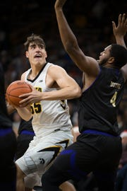 Iowa center Luka Garza averages 12.6 points not because he's a physical specimen, but because he outworks opponents. His next chance comes Saturday against Ohio State star Kaleb Wesson.
