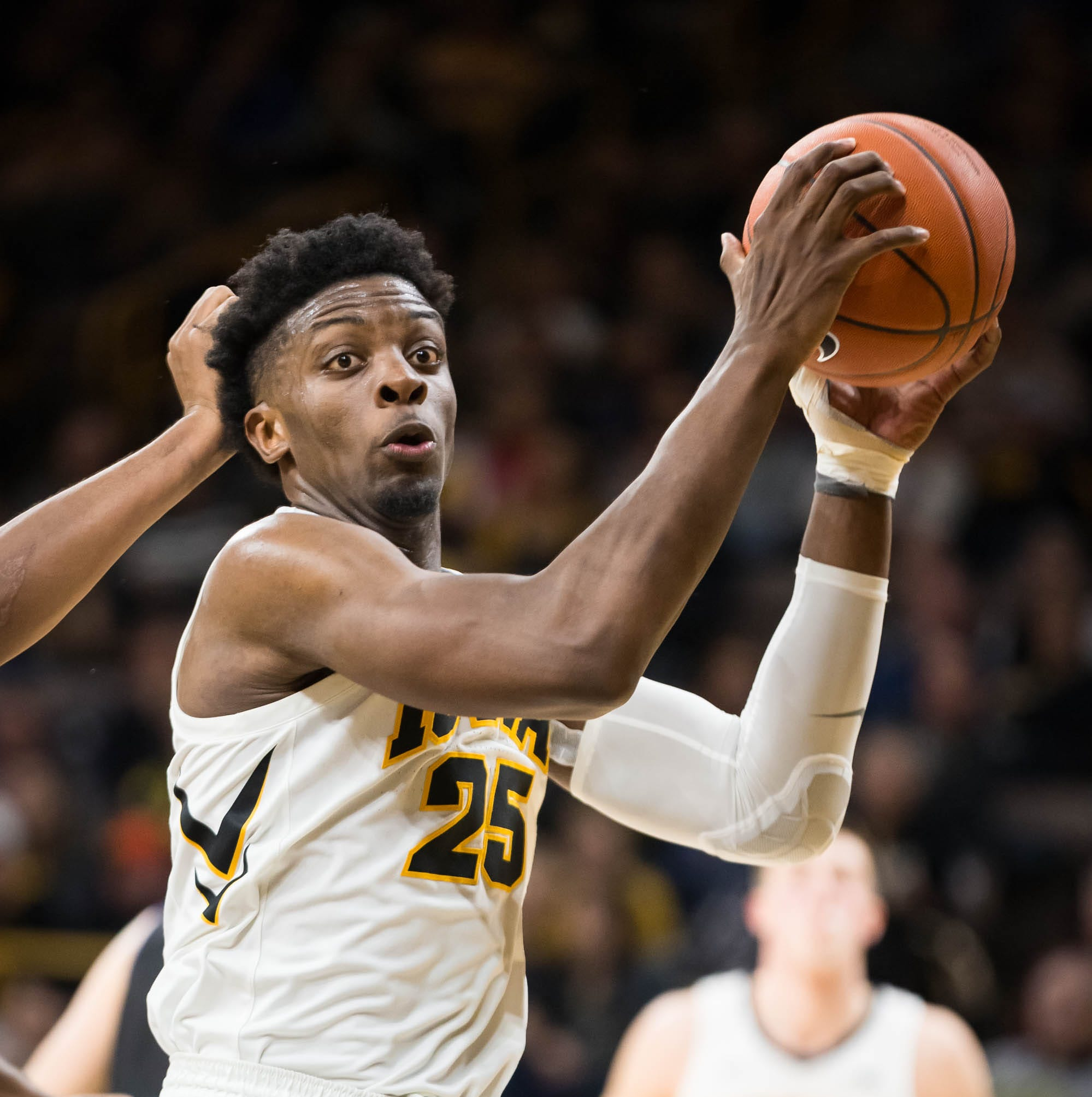 Iowa junior forward Tyler Cook (25) drives against Western Carolina in the first half at Carver Hawkeye Arena in Iowa City on Tuesday, Dec. 18, 2018.