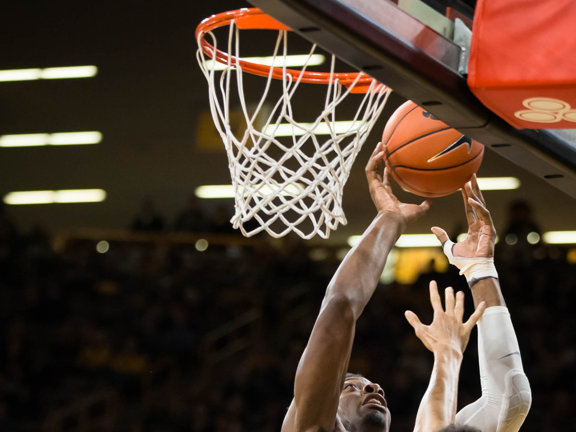 Iowa junior forward Tyler Cook (25) jumps for a layup in the first half at Carver Hawkeye Arena in Iowa City on Tuesday, Dec. 18, 2018.