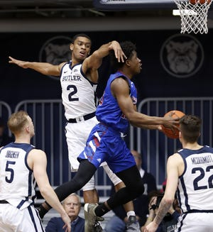 Presbyterian Blue Hose guard Adam Flagler (10) drives by Butler Bulldogs guard Aaron Thompson (2) in the first half of their game at Hinkle Fieldhouse on Monday, Dec. 18, 2018.