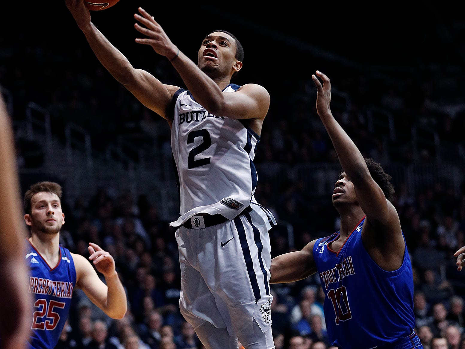 Butler Bulldogs guard Aaron Thompson (2) drives around Presbyterian Blue Hose guard Adam Flagler (10) in the second half of their game at Hinkle Fieldhouse on Monday, Dec. 18, 2018.