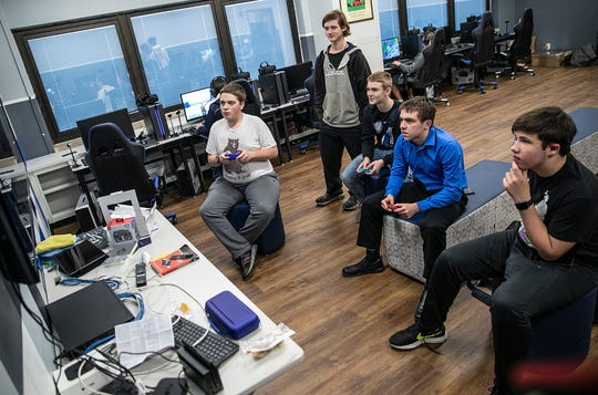 A group of students plays Nintendo games in the new eSports facility at Tipton High School in Tipton, Ind., on Dec. 13, 2018. The state-of-the-art lab features 12 gaming stations and Virtual Reality headsets, and other gaming consoles including a Nintendo Switch and Wii. Quickly growing in popularity, eSports are online competitive multiplayer video games, such as League of Legends and Overwatch.