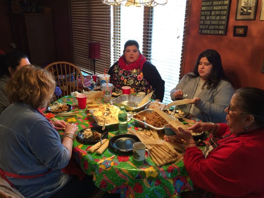 Family members prepare tamales at a tamalada at the home of Dolores Quiroz on Jan. 8, 2018.