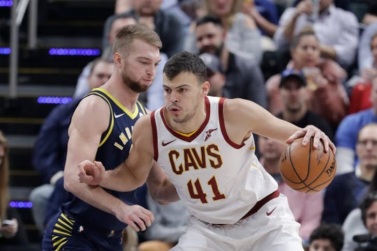 Cleveland Cavaliers' Ante Zizic (41) is defended by Indiana Pacers' Domantas Sabonis during the first half of an NBA basketball game, Tuesday, Dec. 18, 2018, in Indianapolis.