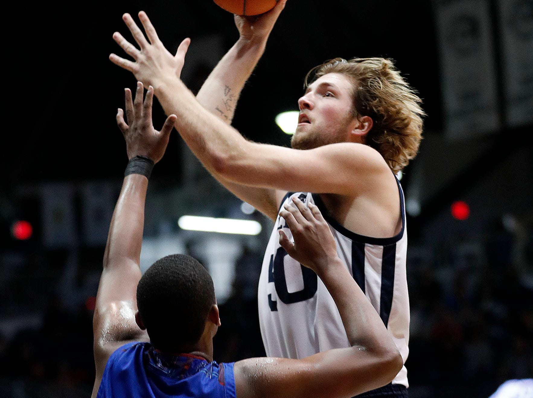 Butler Bulldogs forward Joey Brunk (50) shoots over Presbyterian Blue Hose forward Cory Hightower (12) in the second half of their game at Hinkle Fieldhouse on Monday, Dec. 18, 2018.