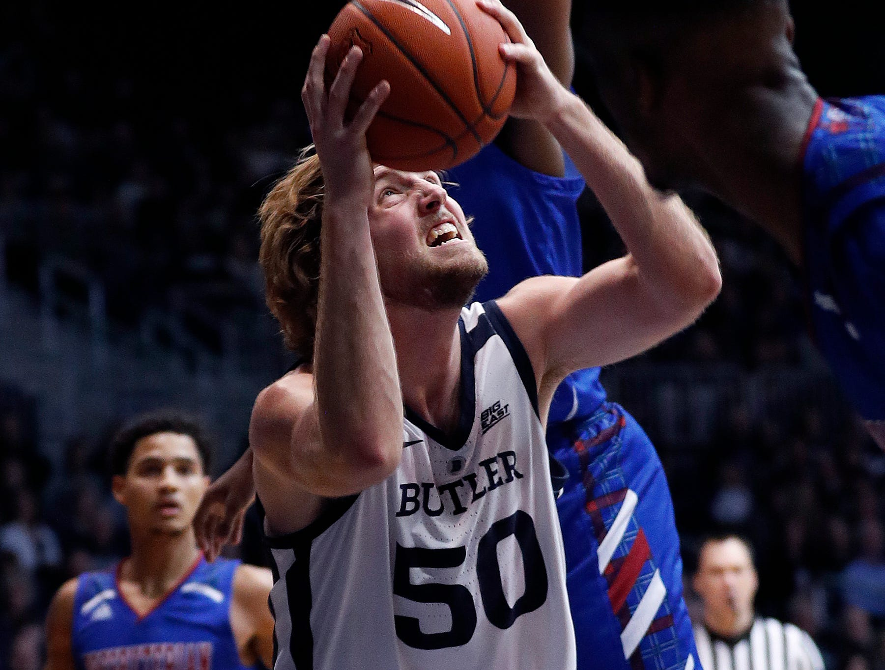 Butler Bulldogs forward Joey Brunk (50) makes a move to the basket on the Presbyterian Blue Hose defenders in the second half of their game at Hinkle Fieldhouse on Monday, Dec. 18, 2018.