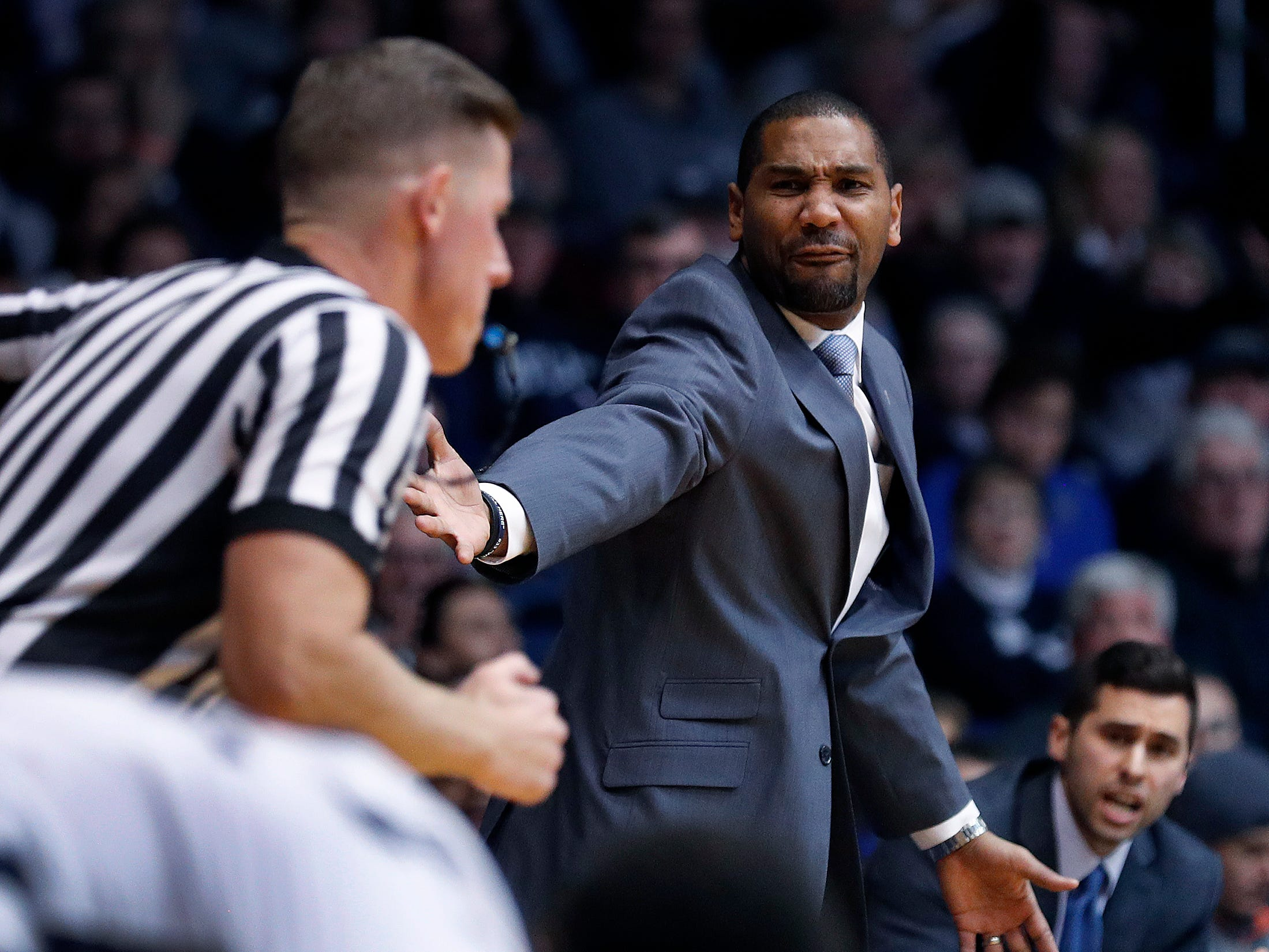 Butler Bulldogs head coach LaVall Jordan  has some words for official James Breeding, left, in the second half of their game at Hinkle Fieldhouse on Monday, Dec. 18, 2018.