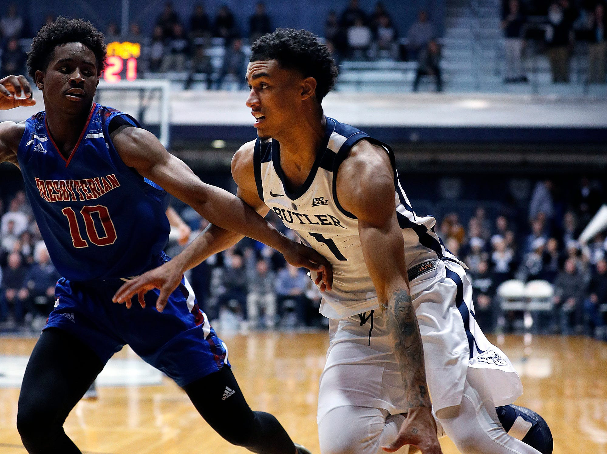 Butler Bulldogs forward Jordan Tucker (1) drives on Presbyterian Blue Hose guard Adam Flagler (10)  in the second half of their game at Hinkle Fieldhouse on Monday, Dec. 18, 2018.
