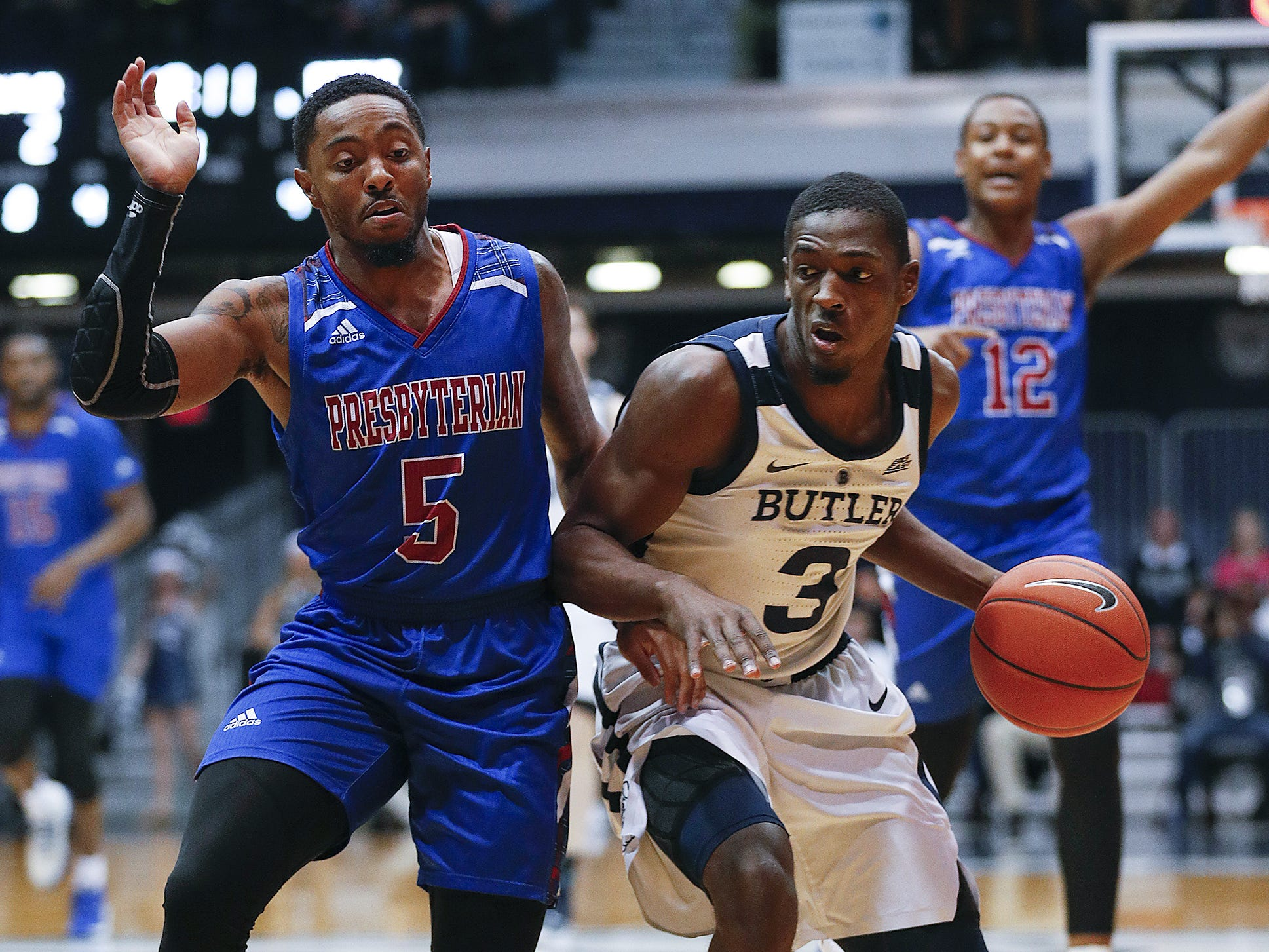 Butler Bulldogs guard Kamar Baldwin (3) drives on Presbyterian Blue Hose guard Davon Bell (5) in the first half of their game at Hinkle Fieldhouse on Monday, Dec. 18, 2018.