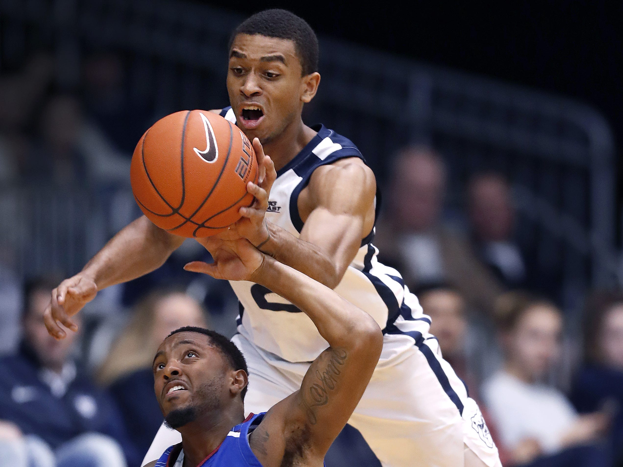 Butler Bulldogs guard Aaron Thompson (2) steals the ball from Presbyterian Blue Hose guard Davon Bell (5) in the first half of their game at Hinkle Fieldhouse on Monday, Dec. 18, 2018.