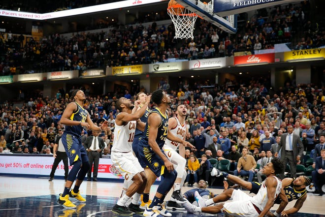 Dec 18, 2018; Indianapolis, IN, USA; A tip in at the buzzer by Cleveland Cavaliers forward Larry Nance Jr. (22) gives the Cavaliers a one point victory against the Indiana Pacers during the fourth quarter at Bankers Life Fieldhouse.