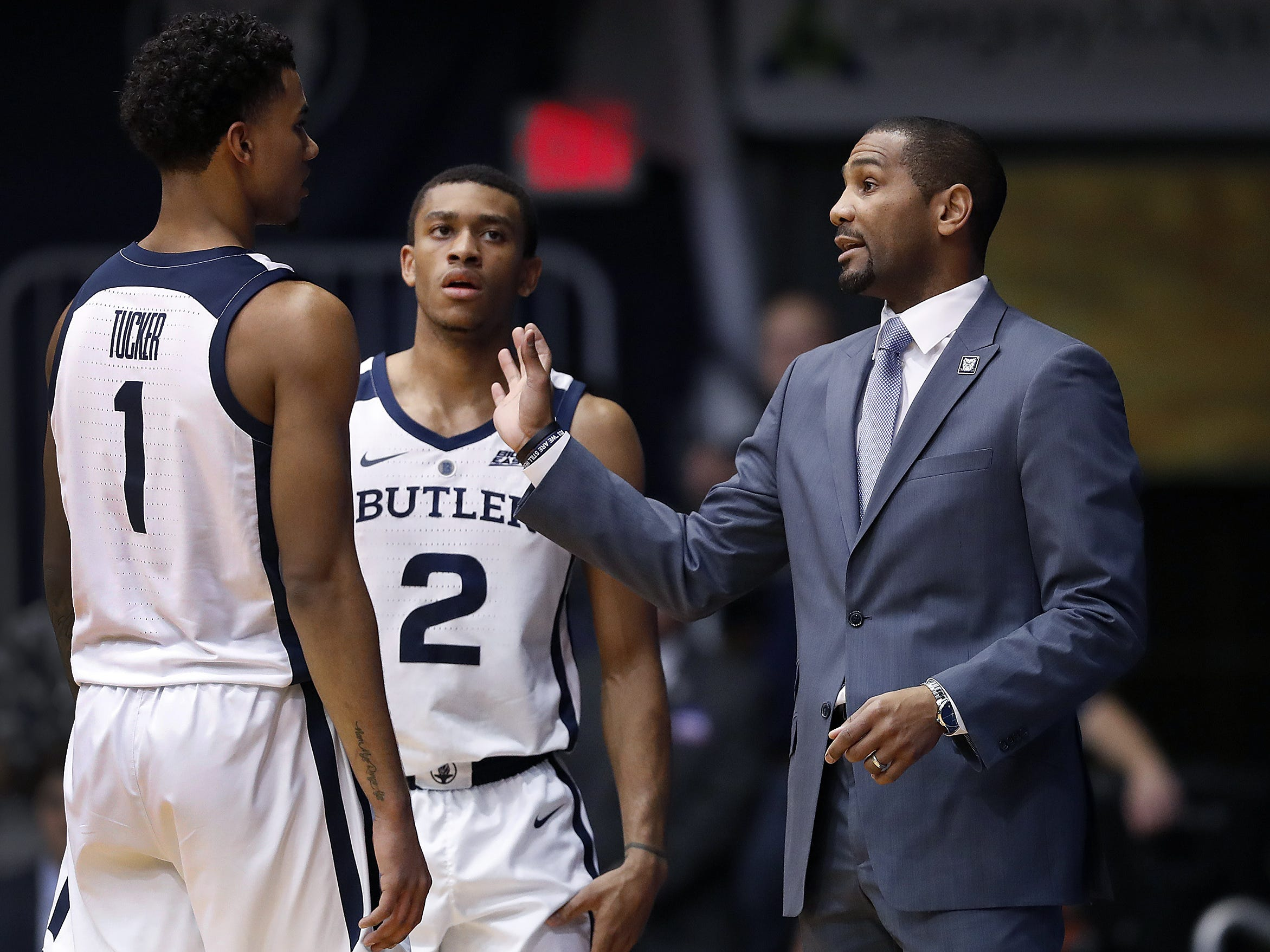 Butler Bulldogs head coach LaVall Jordan talks to Jordan Tucker (1) in the first half of their game at Hinkle Fieldhouse on Monday, Dec. 18, 2018.