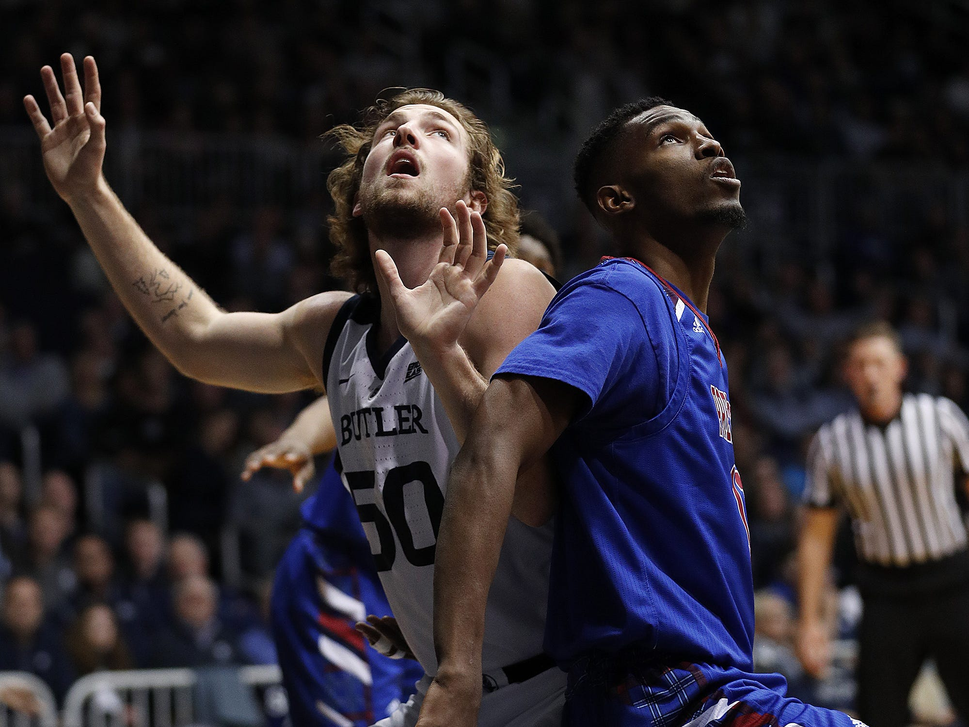 Butler Bulldogs forward Joey Brunk (50) and Presbyterian Blue Hose center Armel TeTe (11) fight for position for a rebound in the first half of their game at Hinkle Fieldhouse on Monday, Dec. 18, 2018.