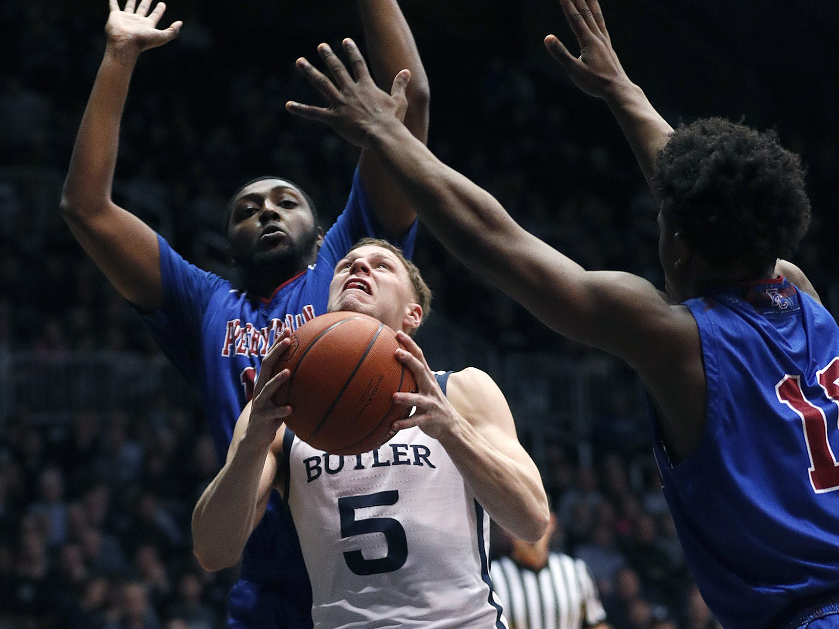 Butler Bulldogs guard Paul Jorgensen (5) shoots on Presbyterian Blue Hose guard Adam Flagler (10) in the first half of their game at Hinkle Fieldhouse on Monday, Dec. 18, 2018.