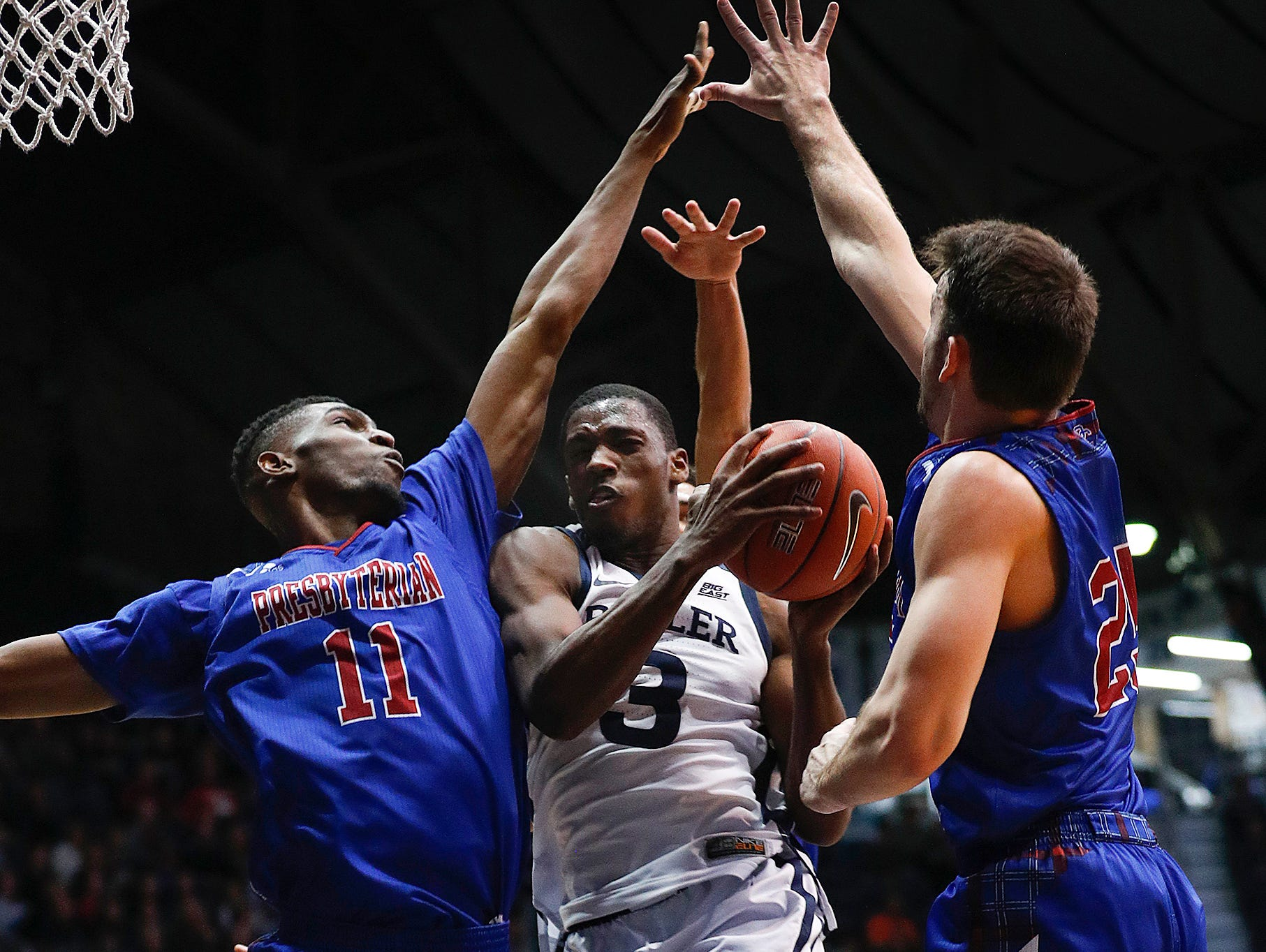 Butler Bulldogs guard Kamar Baldwin (3) is fouled by Presbyterian Blue Hose center Armel TeTe (11) in the second half of their game at Hinkle Fieldhouse on Monday, Dec. 18, 2018.