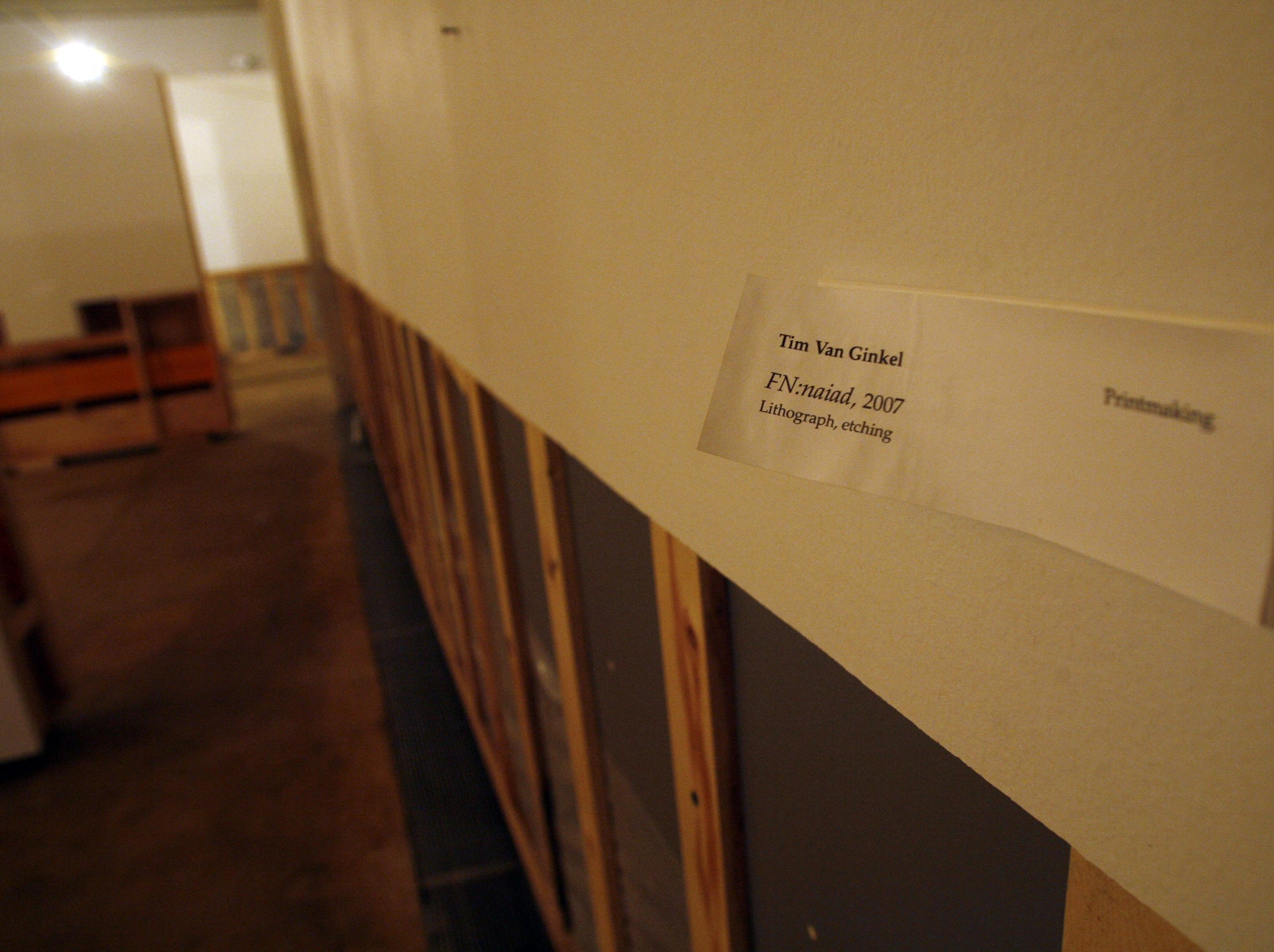 A placard for a piece of art remains on the wall during cleanup efforts at the UI Museum of Art, Wednesday, August 6, 2008, on the University of Iowa campus, in Iowa City, Iowa.