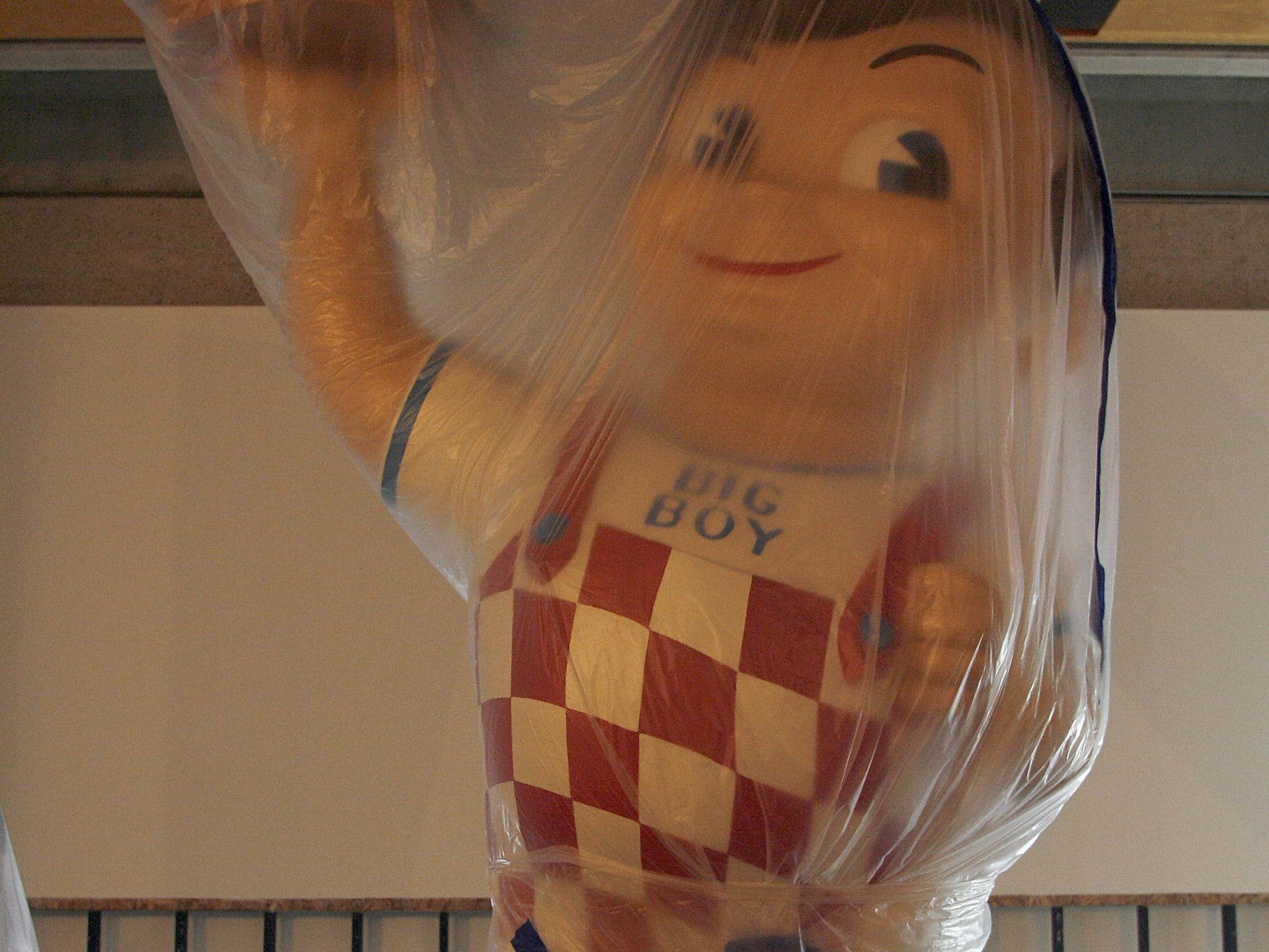 "A large ""Big Boy"" statue which was part of an MFA project remains covered in plastic on the main floor of the UI Museum of Art, Wednesday, August 6, 2008, on the University of Iowa campus, in Iowa City, Iowa."