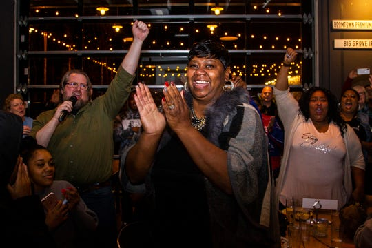 Royceann Porter celebrates with supporters following her victory for Johnson County Supervisor during at a special election watch party on Tuesday, Dec. 18, 2018, at Big Grove Brewery in Iowa City.