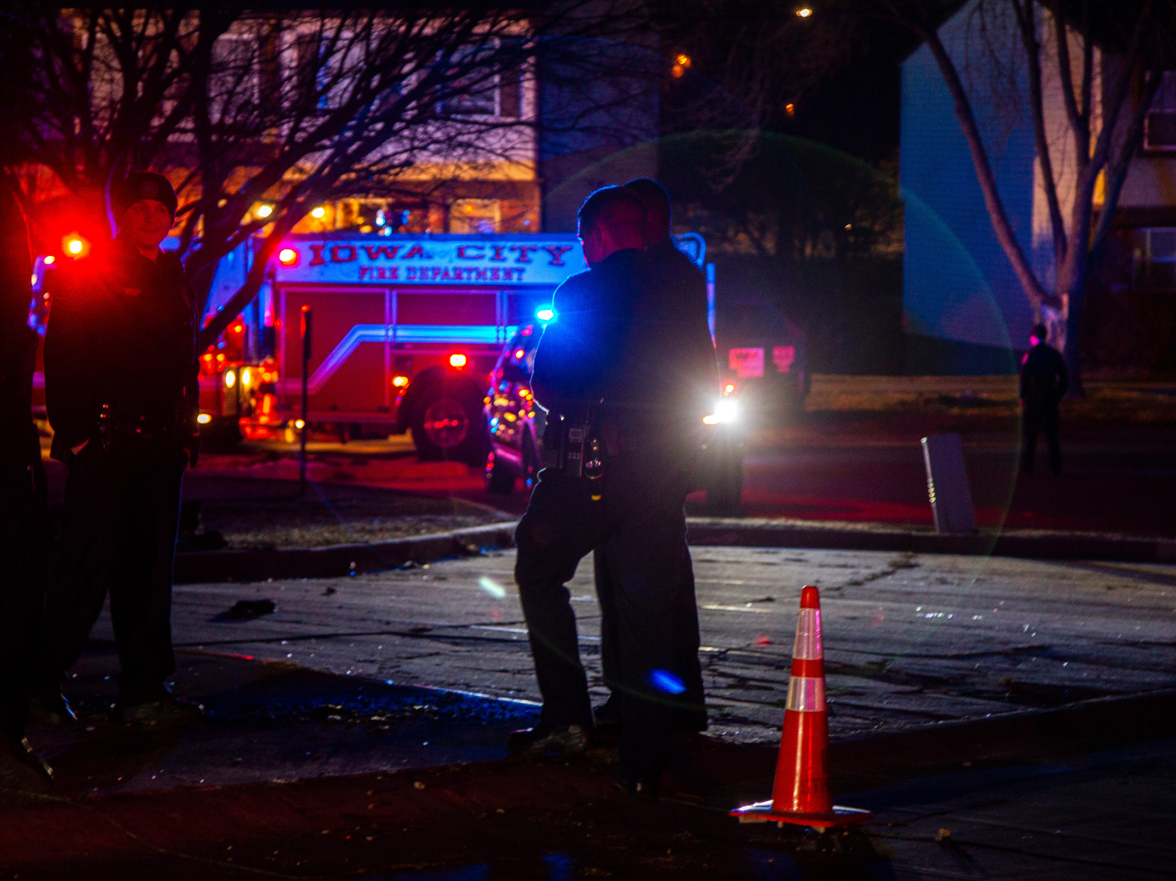Iowa City and Coralville firefighters respond to a structure fire call on Tuesday, Dec. 18, 2018, along Clearwater Court on the west side of Iowa City.