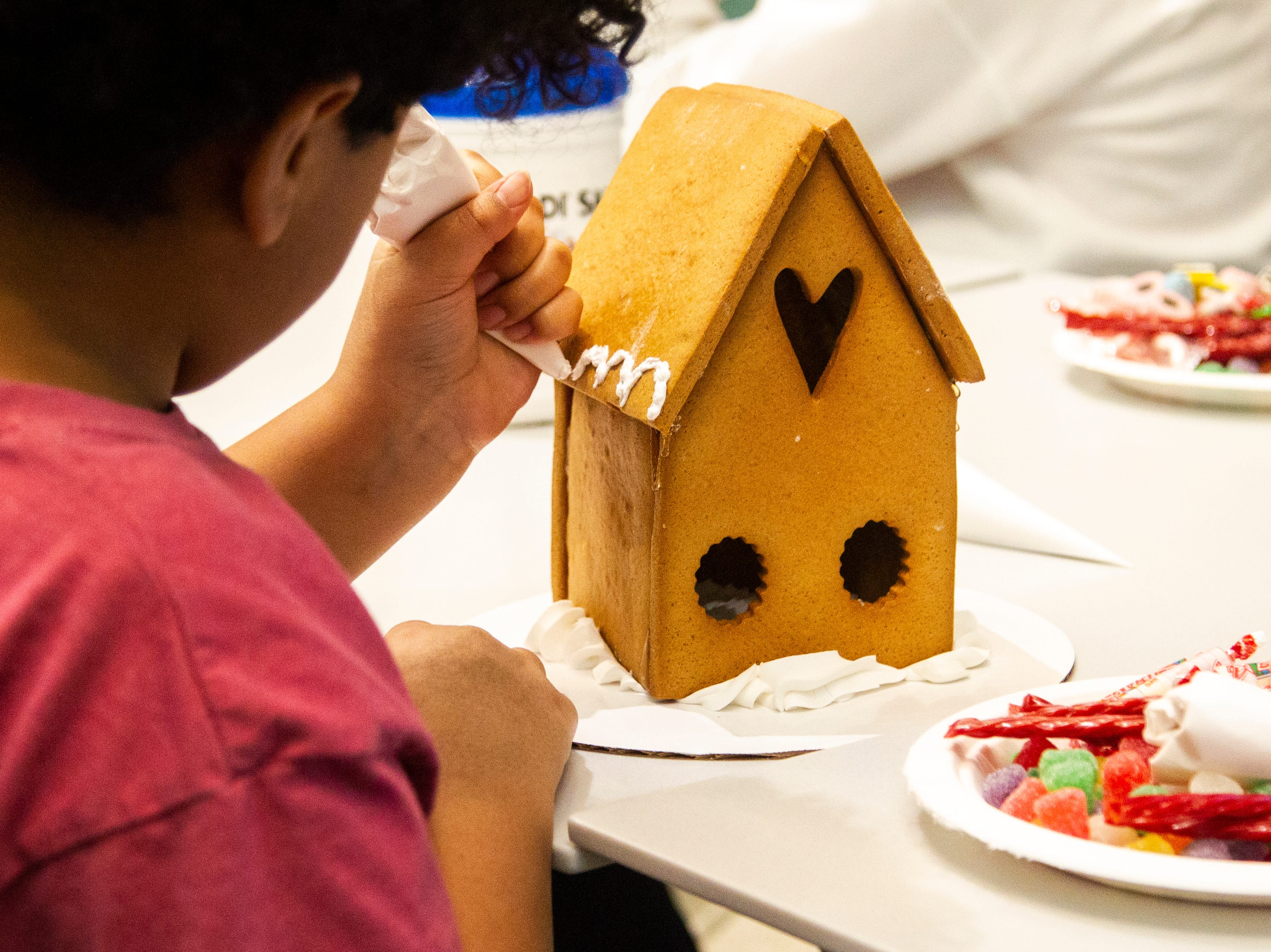 Sedalia Cason picks out decorations for her gingerbread house during an event on Tuesday, Dec. 18, 2018, at the Stead Family Children's Hospital in Iowa City.