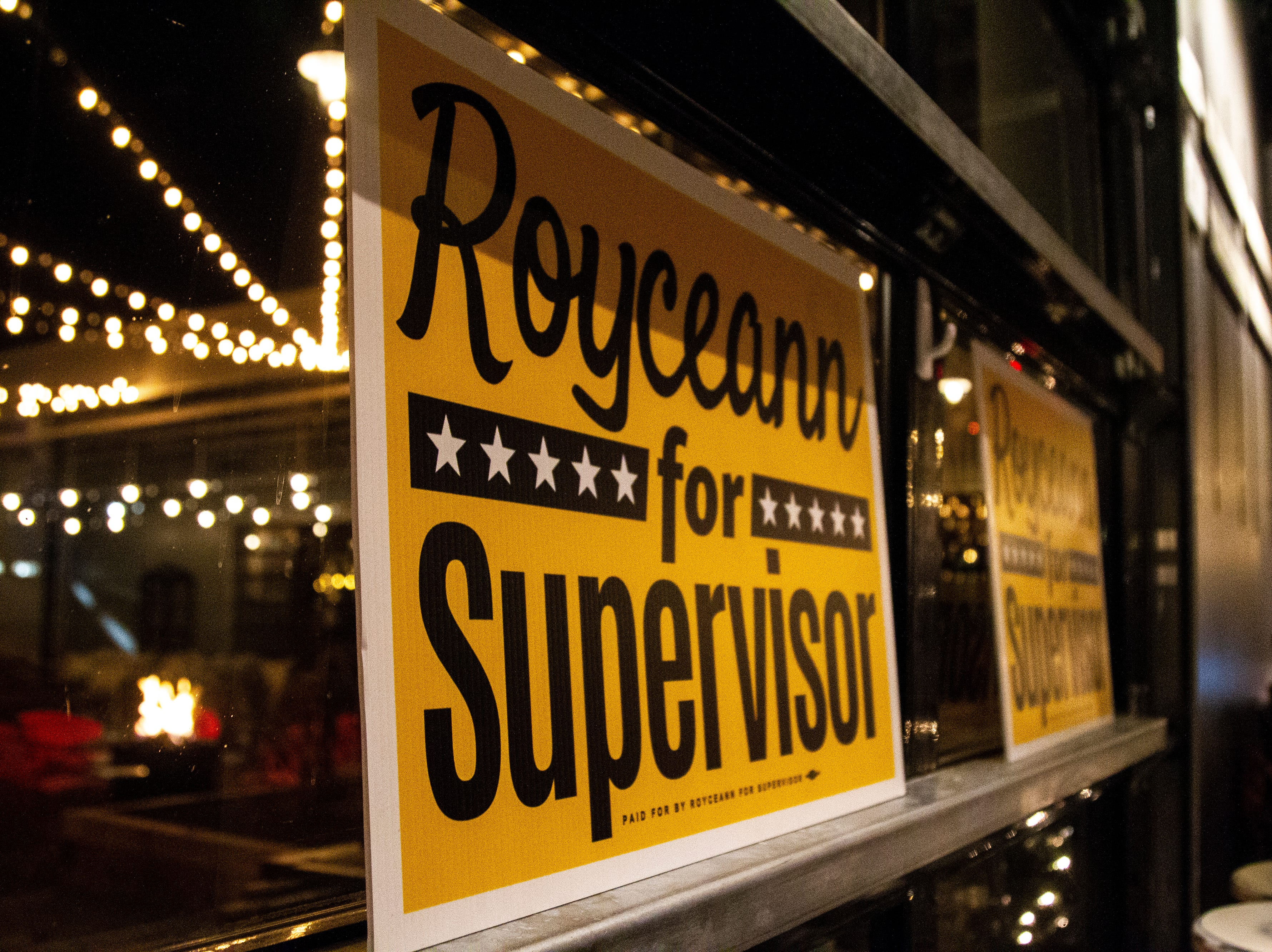 Royceann for Supervisor signs sit on a ledge during a special election watch party on Tuesday, Dec. 18, 2018, at Big Grove Brewery in Iowa City.