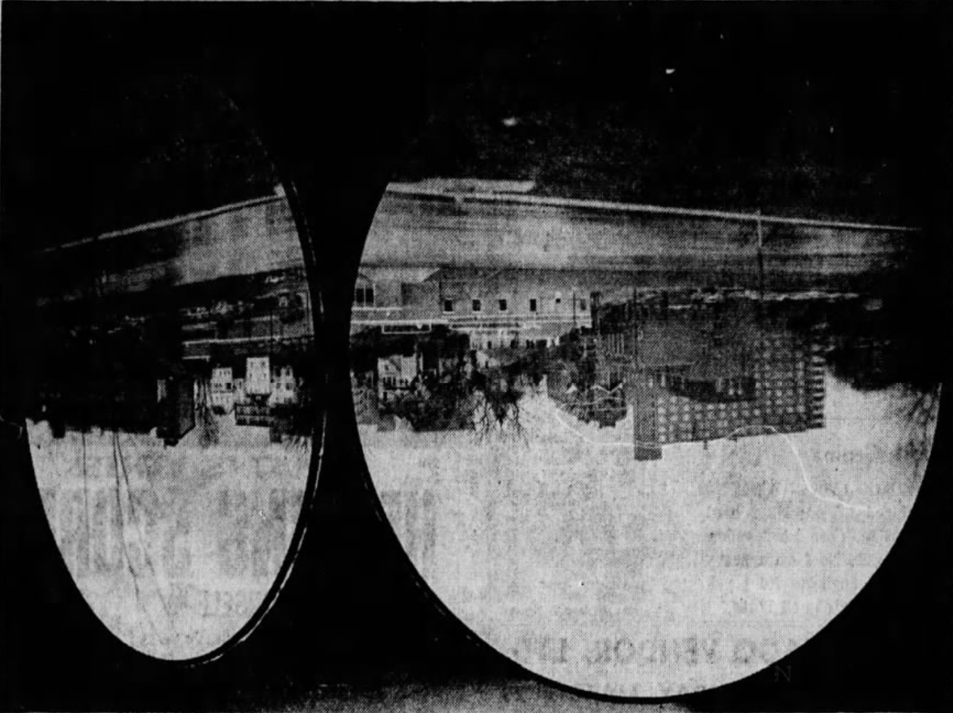 "This March 25, 1971 Press-Citizen newspaper clipping, originally published with the caption, ""'IOWA VIEW' - This upside-down view was created by New York artist Ted Victoria in a darkened gallery of the University of Iowa Museum of Art overlooking the Iowa River,"" it read. ""To focus the view from across the river on the round screens six and a half feet in diameter, Victoria placed a large lens in the center of the gallery window (behind the screen at the right), covered the rest of the window with black plastic, and positioned the screens at the distance required by the lens. Titled ""Iowa View"" and commissioned for the UI Museum, the unusual work will be shown during Accessions: 1970-71, an exhibition of recently acquired art works which will open May 8 at the museum."""