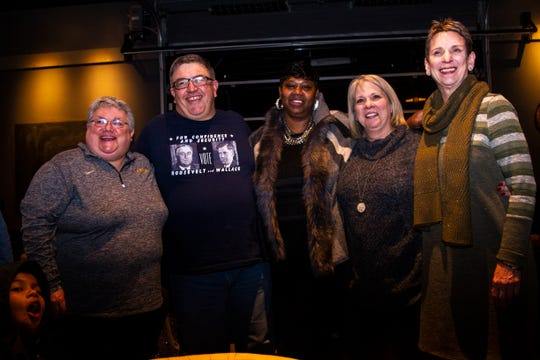 Johnson County Supervisors Janelle Rettig, Rod Sullivan, Royceann Porter, Lisa Green-Douglass and Pat Heiden pose for a photo during a special election watch party on Tuesday, Dec. 18, 2018, at Big Grove Brewery in Iowa City.