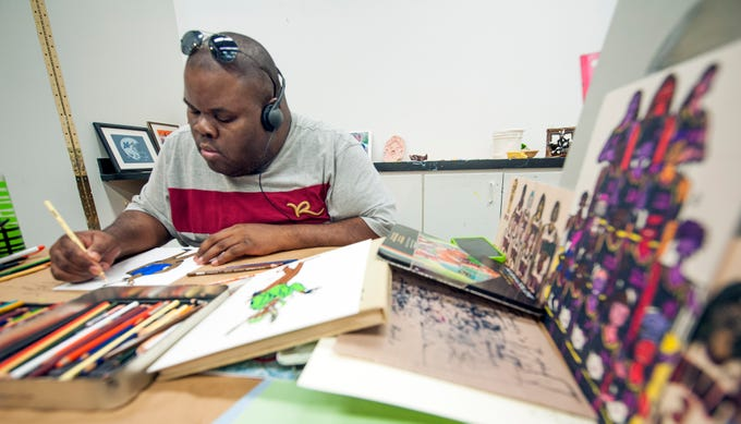 Artist Fred Wright of Jackson works on his version of Santa's reindeer during a VSA Mississippi-sponsored Community Art Group class at the Arts Center of Mississippi in Jackson. An exhibit of work created by the group is hanging at the Arts Center through Jan. 10, 2019. Tuesday, Dec. 18, 2018