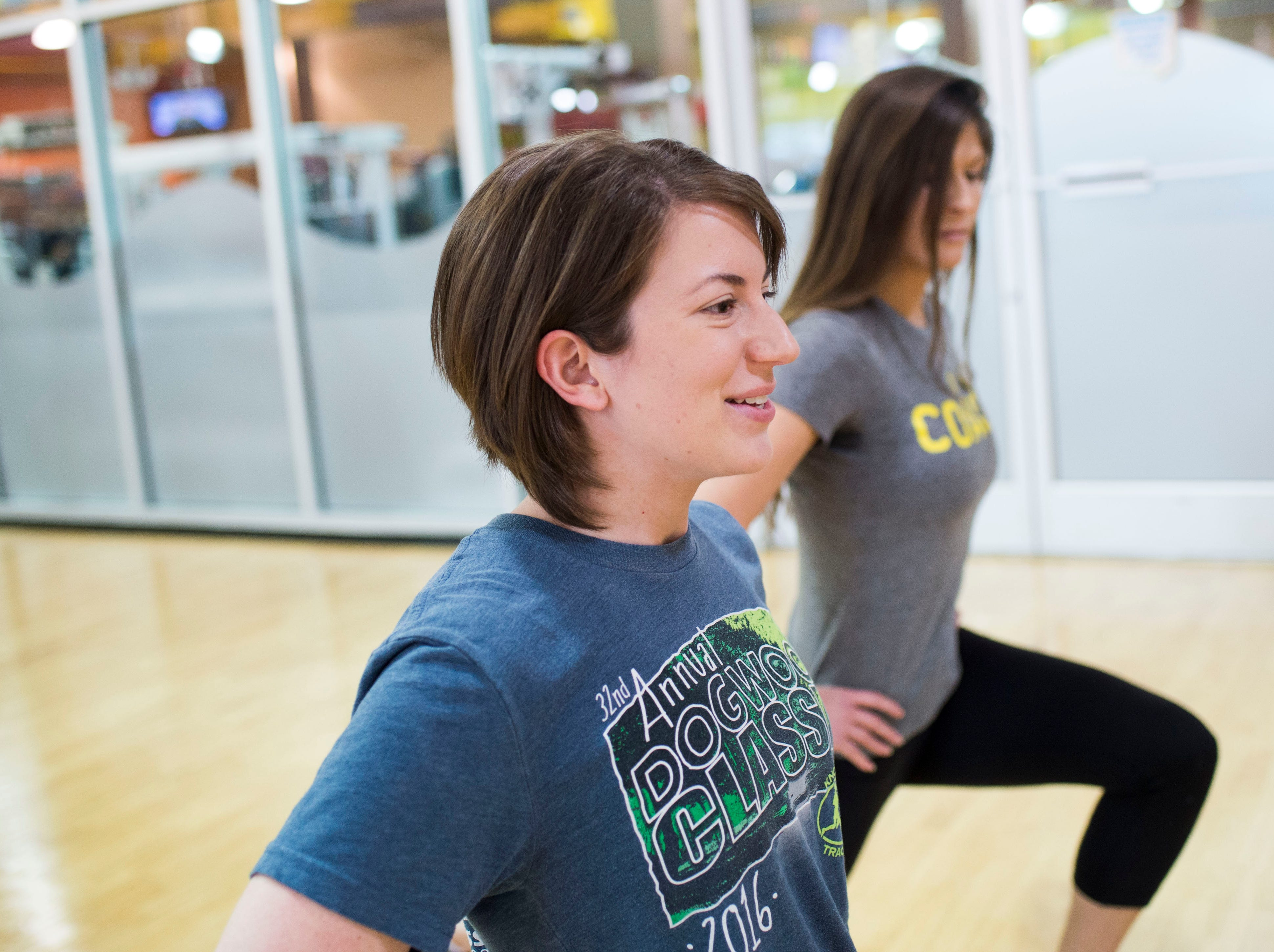 Alcoa Gold's Gym fitness manager Deonna Walker, leads News Sentinel reporter Maggie Jones, in a set of reverse lunges at the Gold's Gym on Kingston Pike  Tuesday, Dec. 19, 2018.