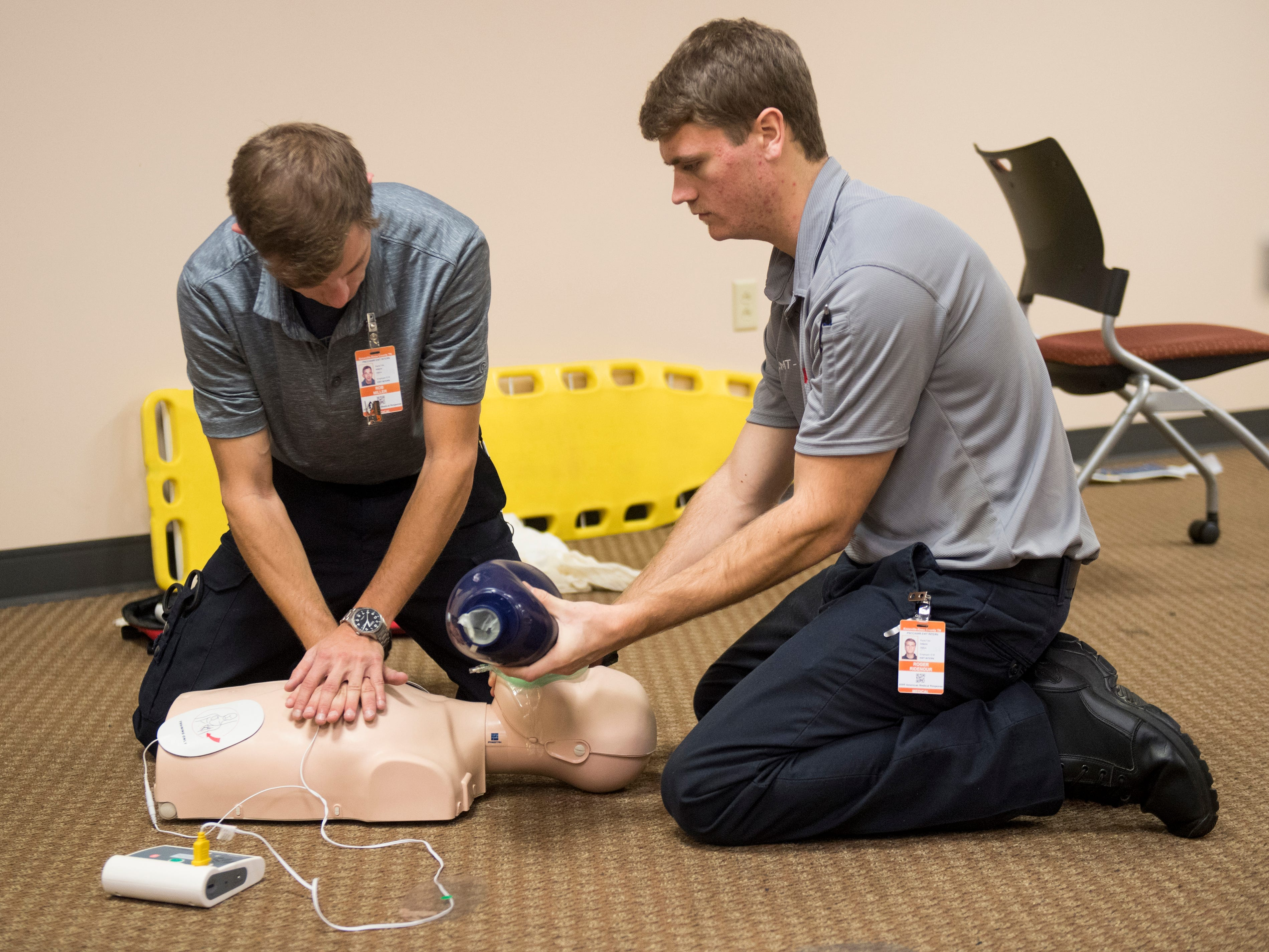 EMT interns Rob Miller, left, and Roger Ridenour, right, practice CPR on a patient experiencing cardiac arrest during a cooperative class between AMR and Pellissippi State on Monday, December 3, 2018.